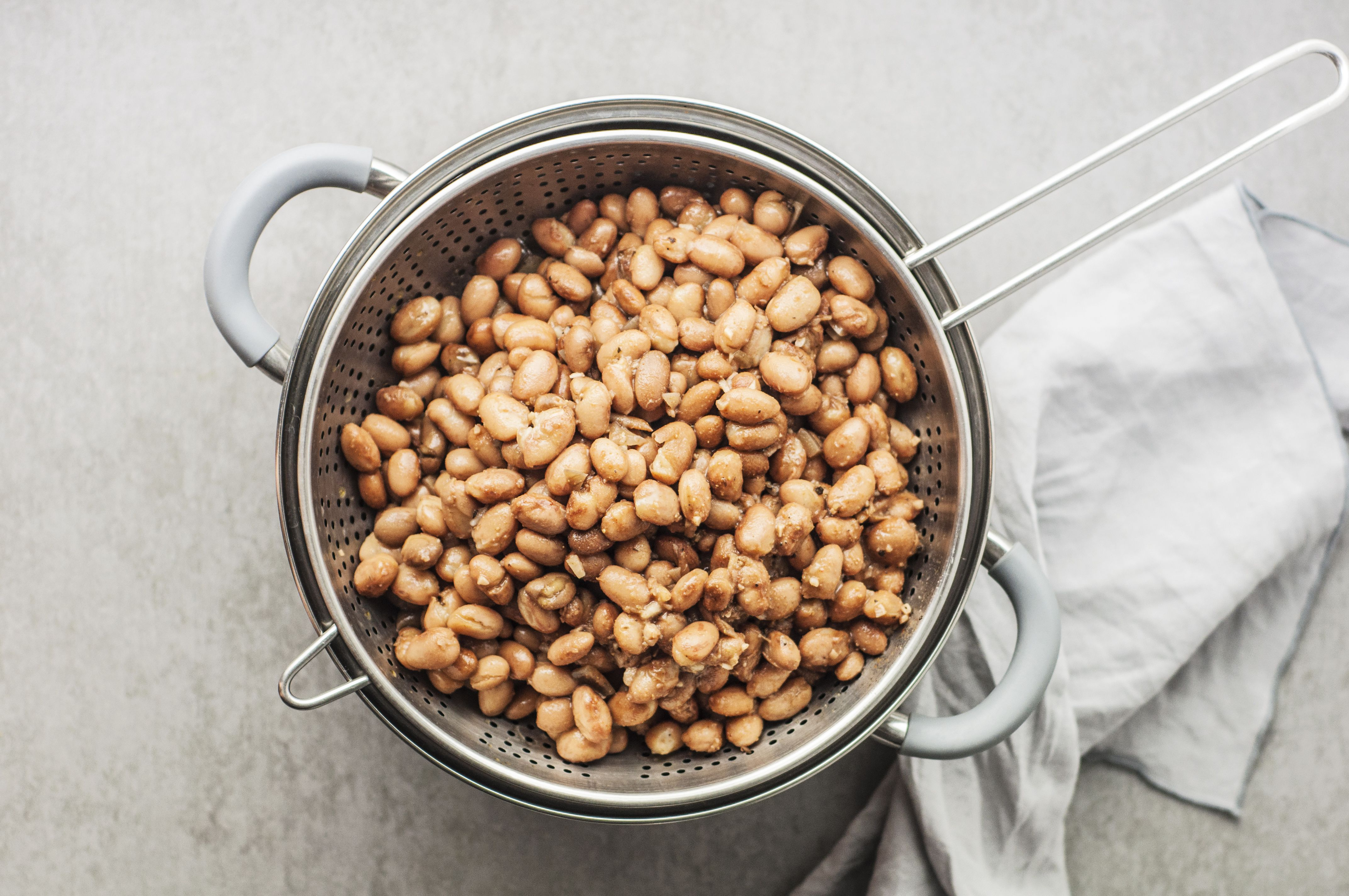 Draining the beans over a bowl
