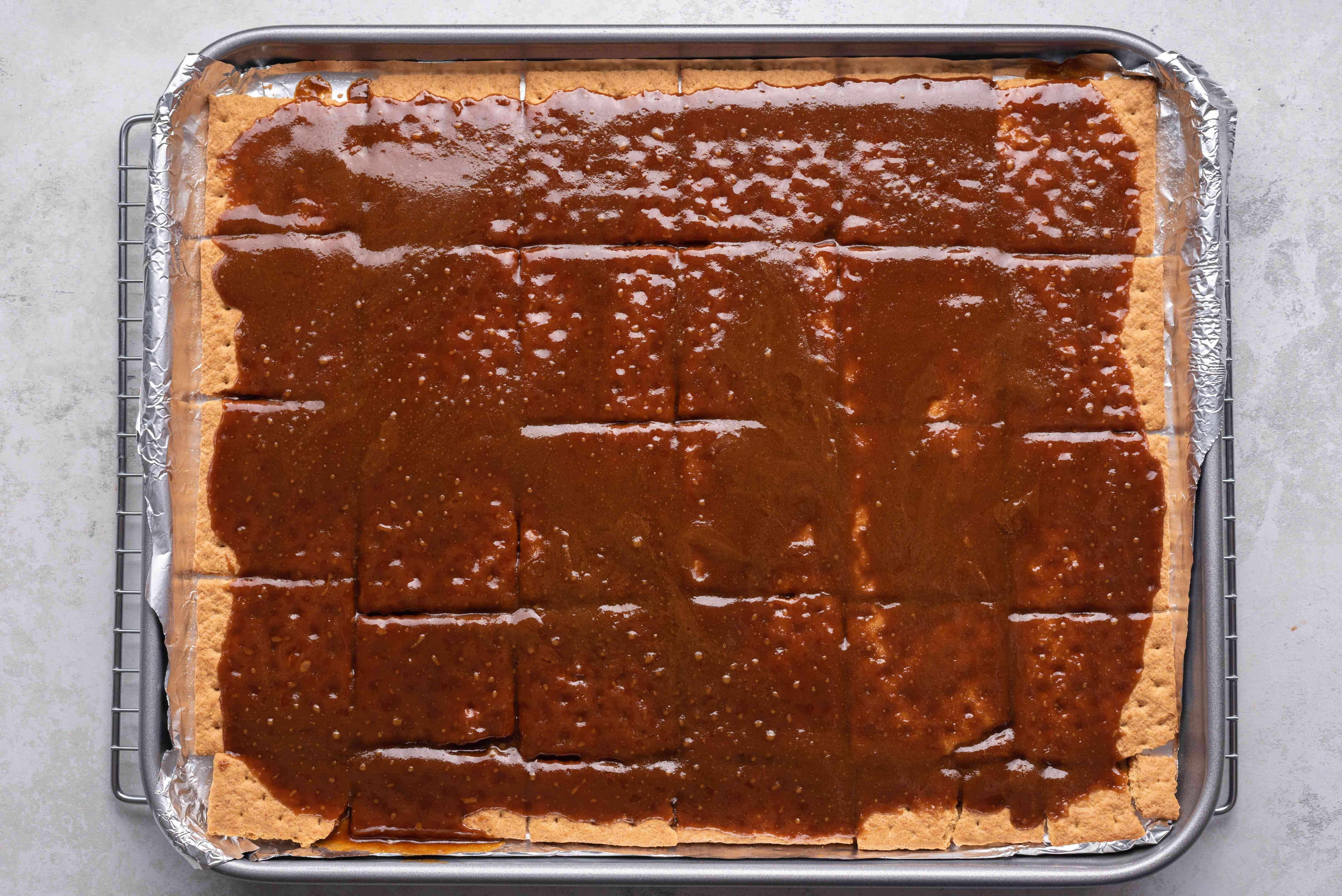 toffee crackers on a baking sheet