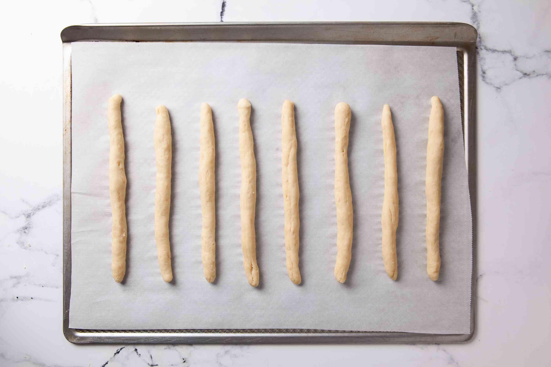 Let breadsticks rise on baking sheet