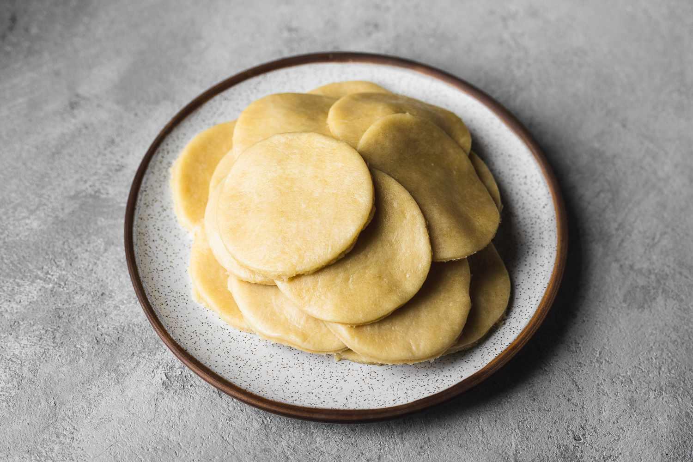 A plate of empanada dough rounds