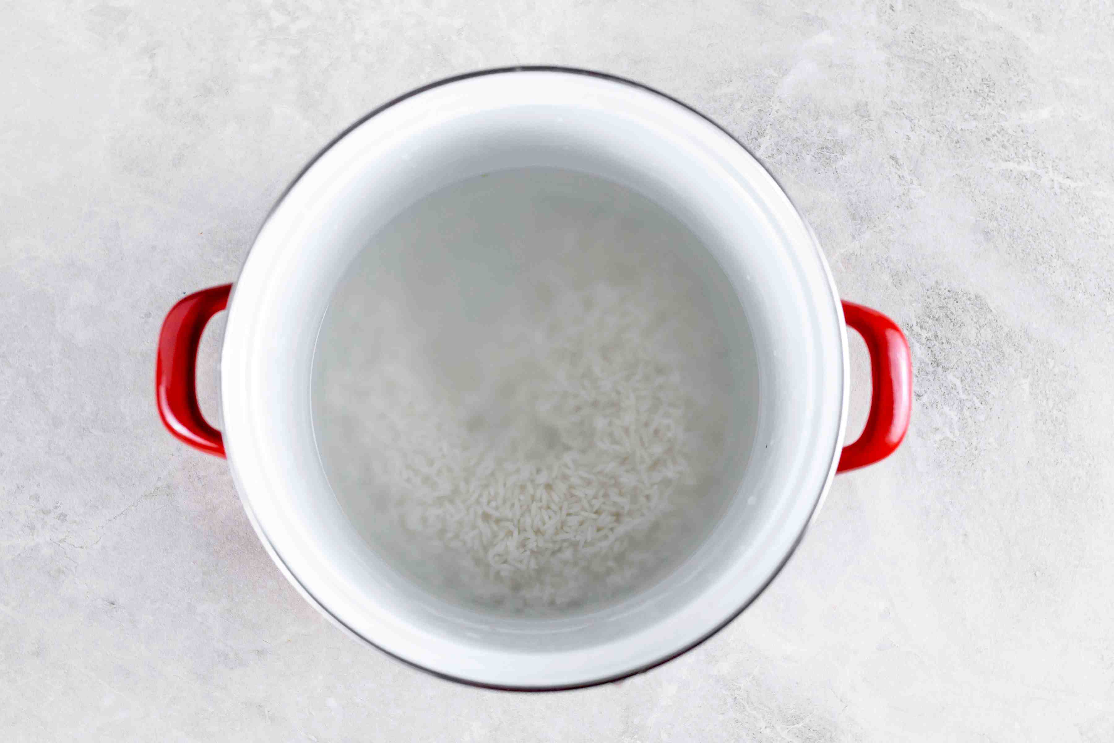 Boil water and add rice