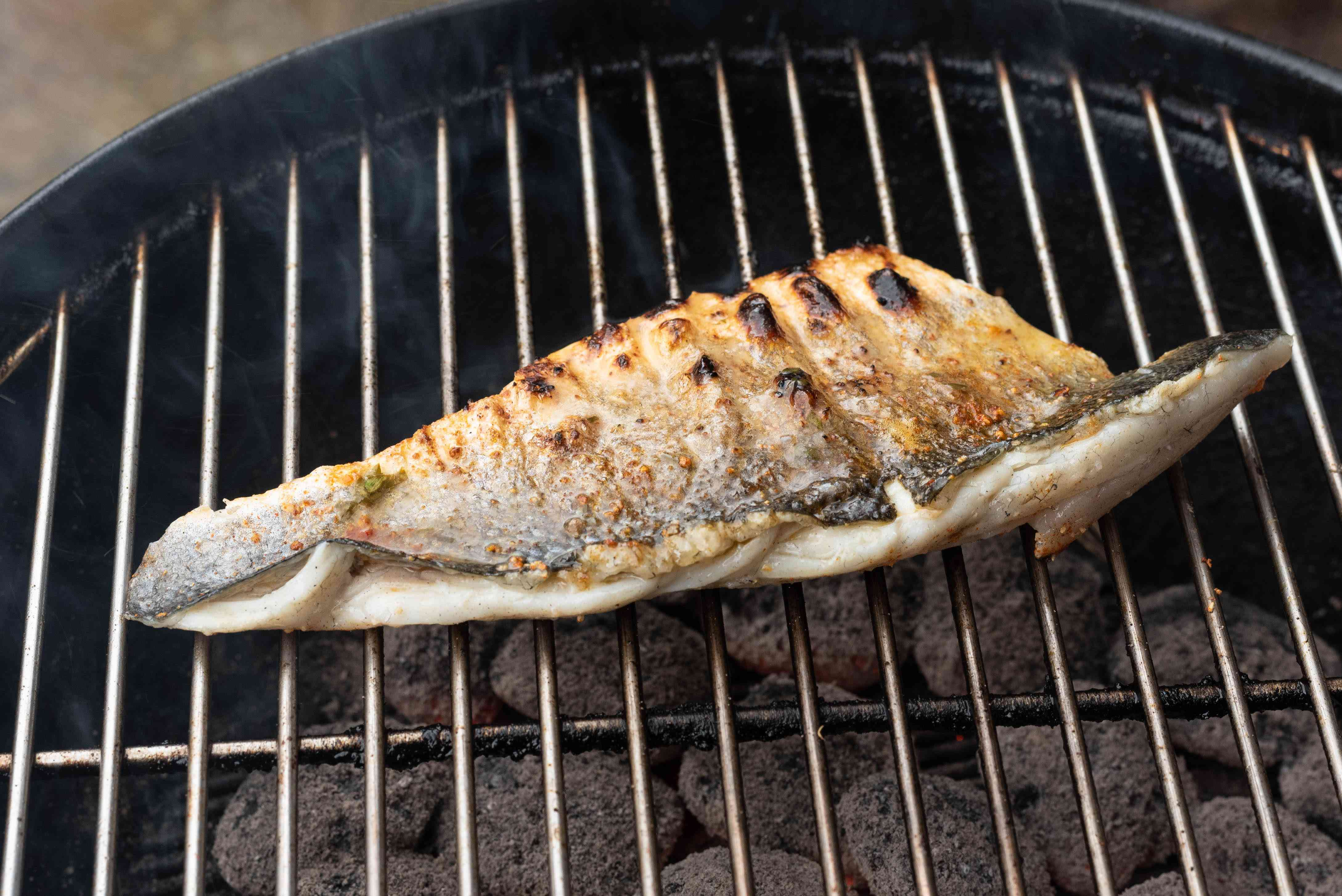 fish cooking on the grill