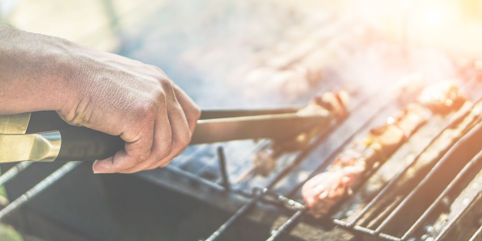 Cropped Image Of Hand Preparing Barbecue