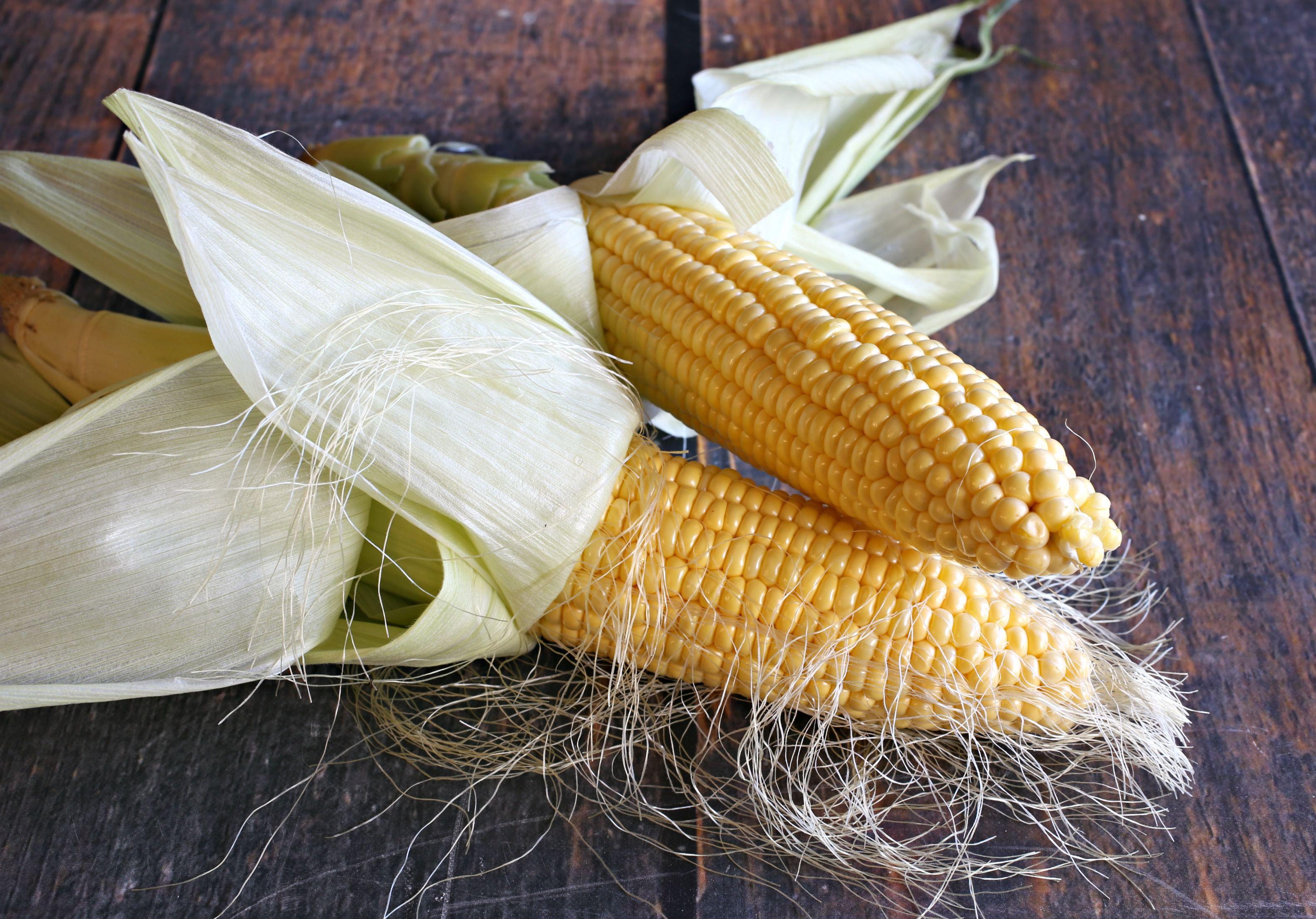 Removing corn husks