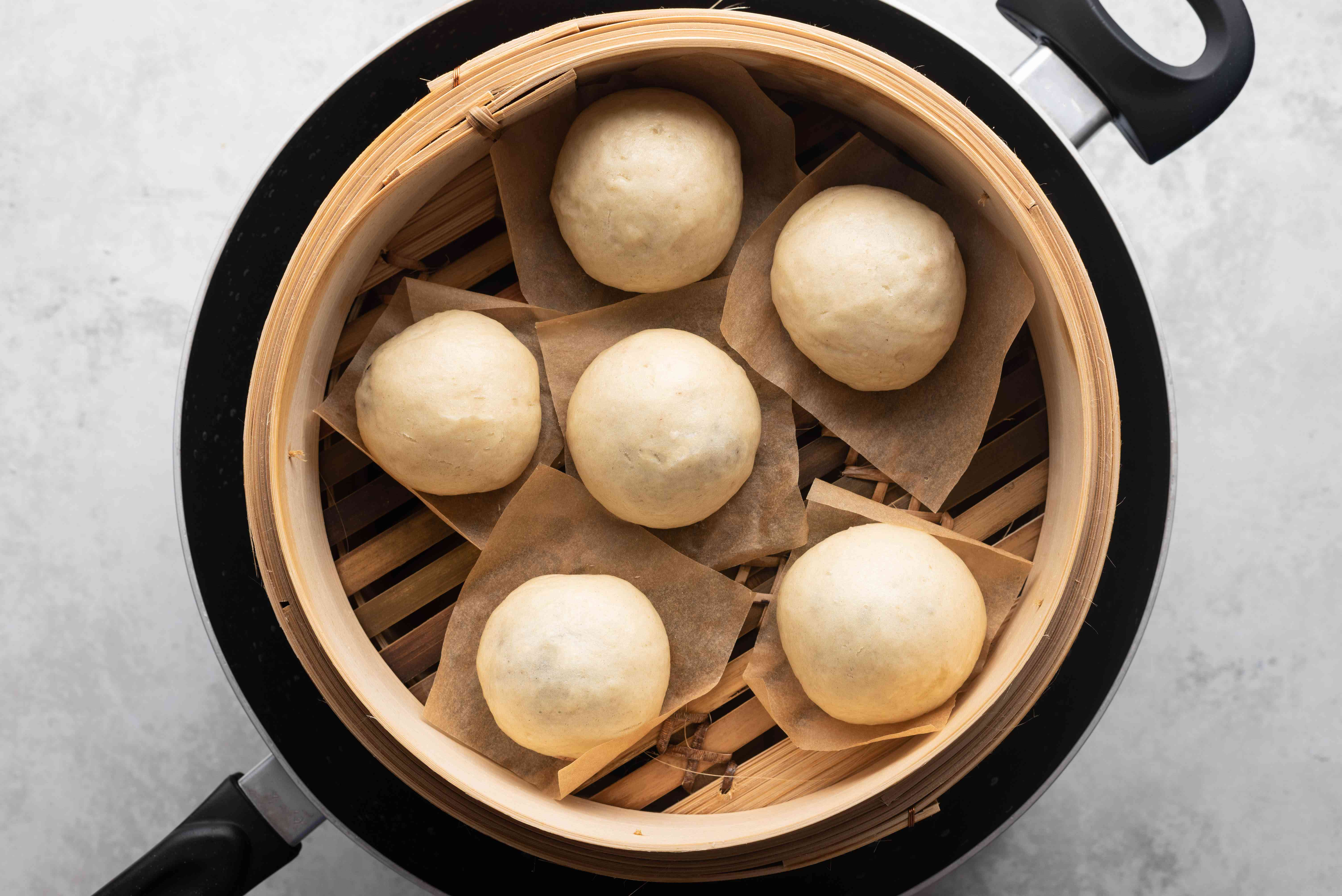 Manju, Japanese Steamed Cake With Sweet Red Bean Filling, in a steamer
