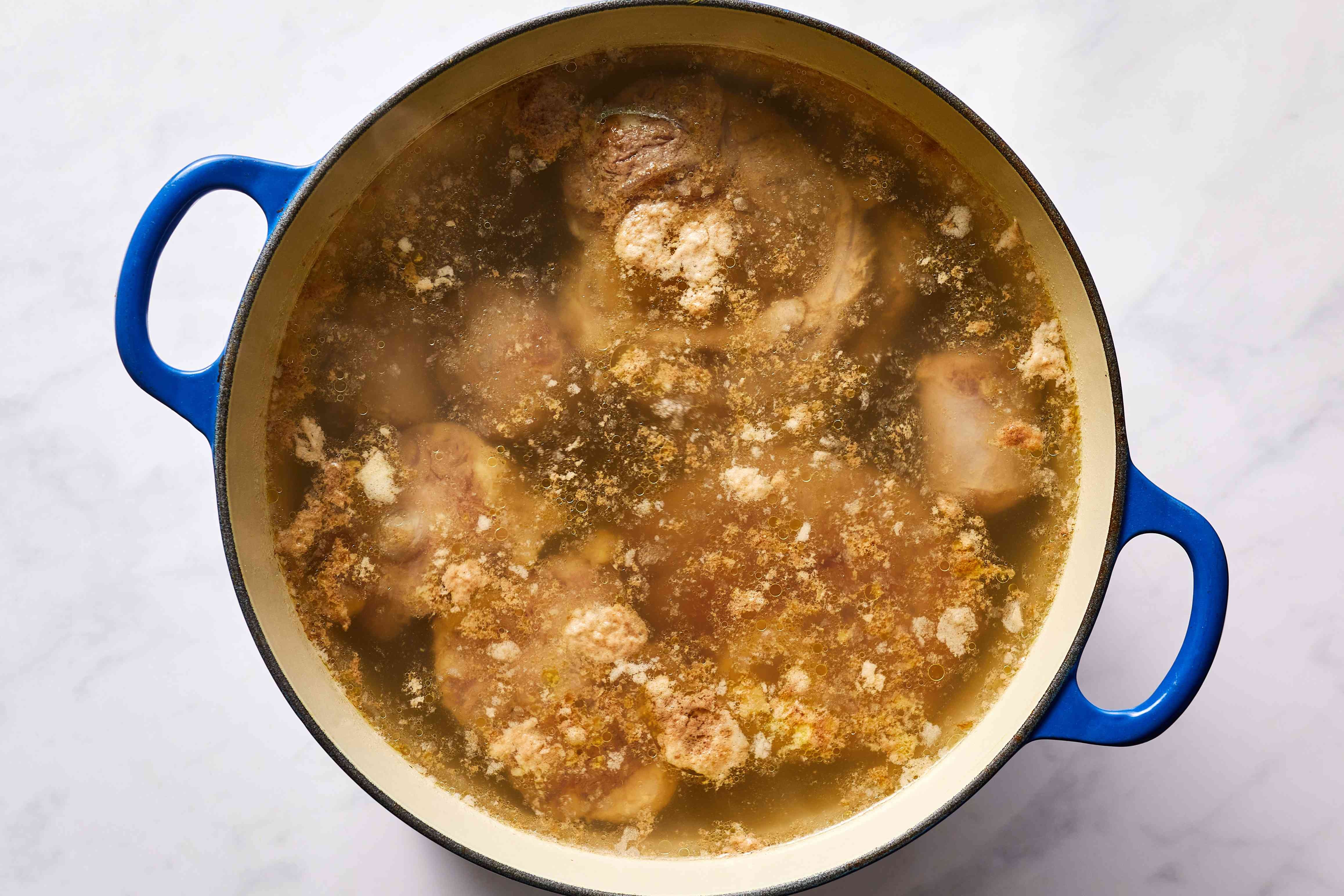 meat and marrow cooking in a pot with water