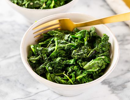 Spinach and other greens in a large bowl for sauteed greens