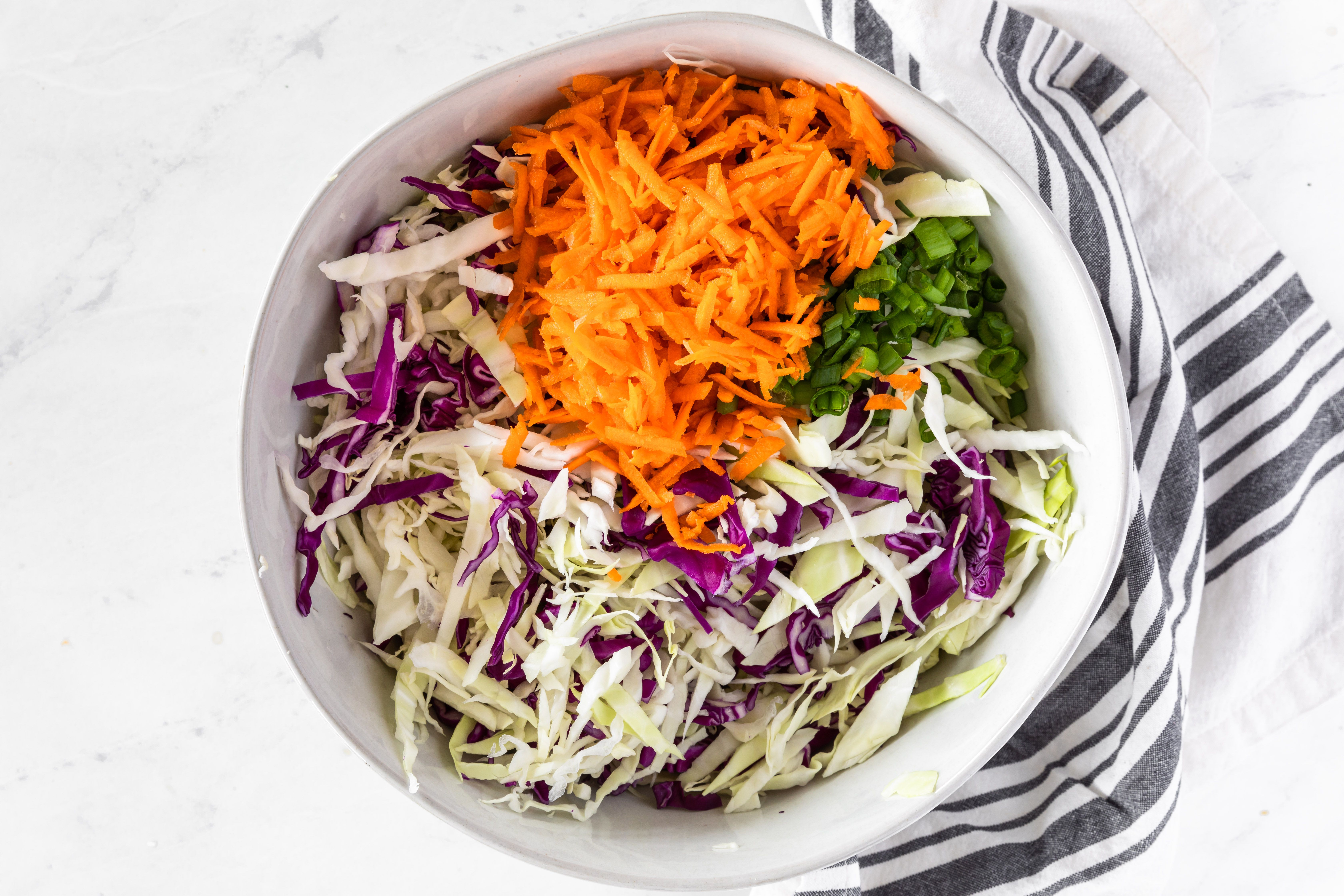 Mix carrots and green onions with the cabbage