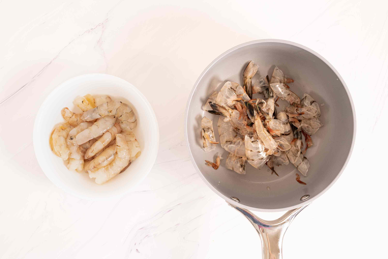 peeled shrimp in a bowl, shrimp shells in a saucepan
