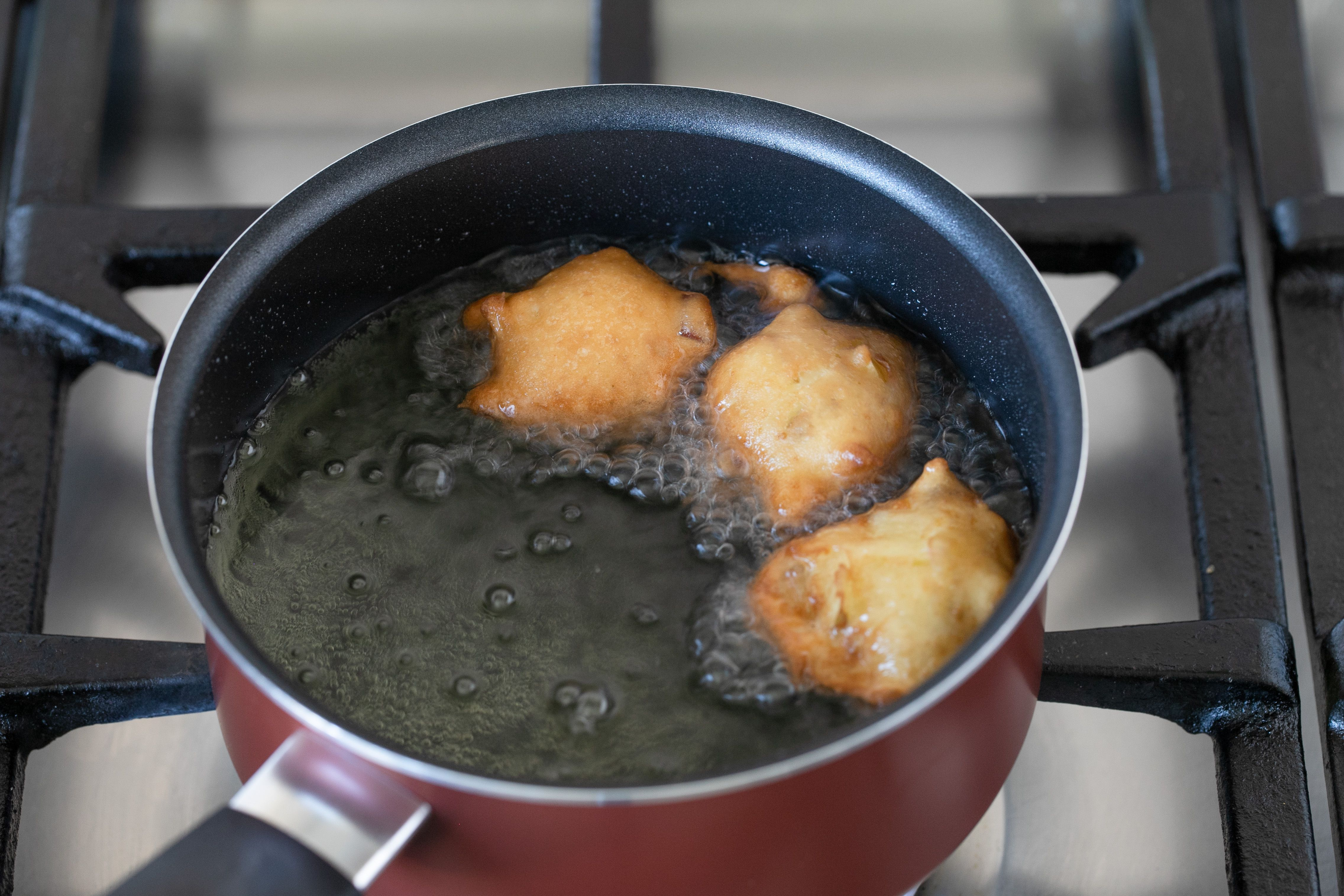 Drop fritters into oil