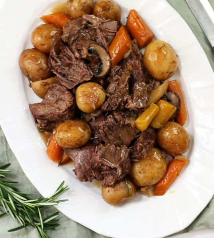 instant pot pot roast, mushrooms and carrots on a white plate