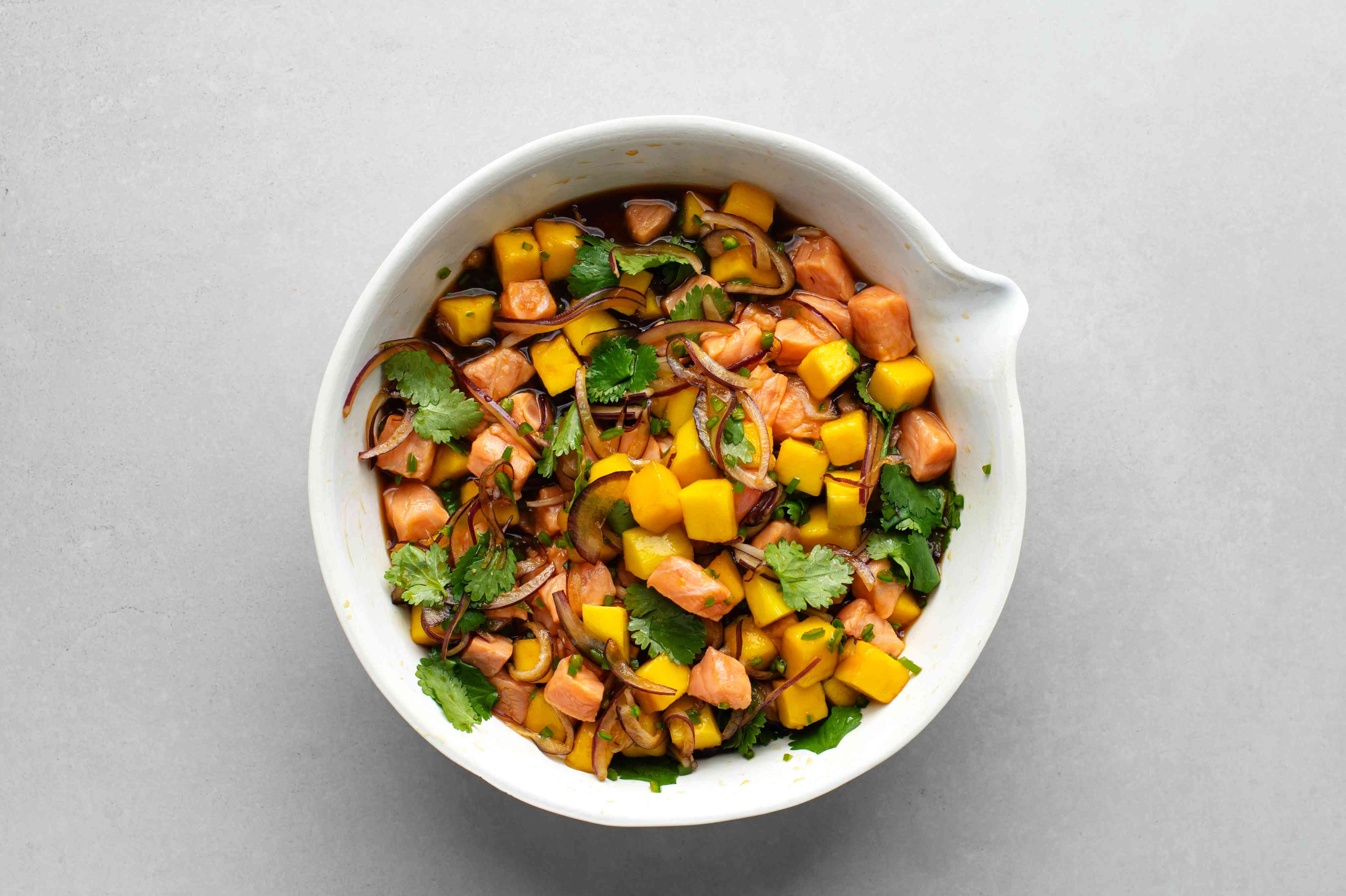 Salmon Ceviche with Mango in a bowl