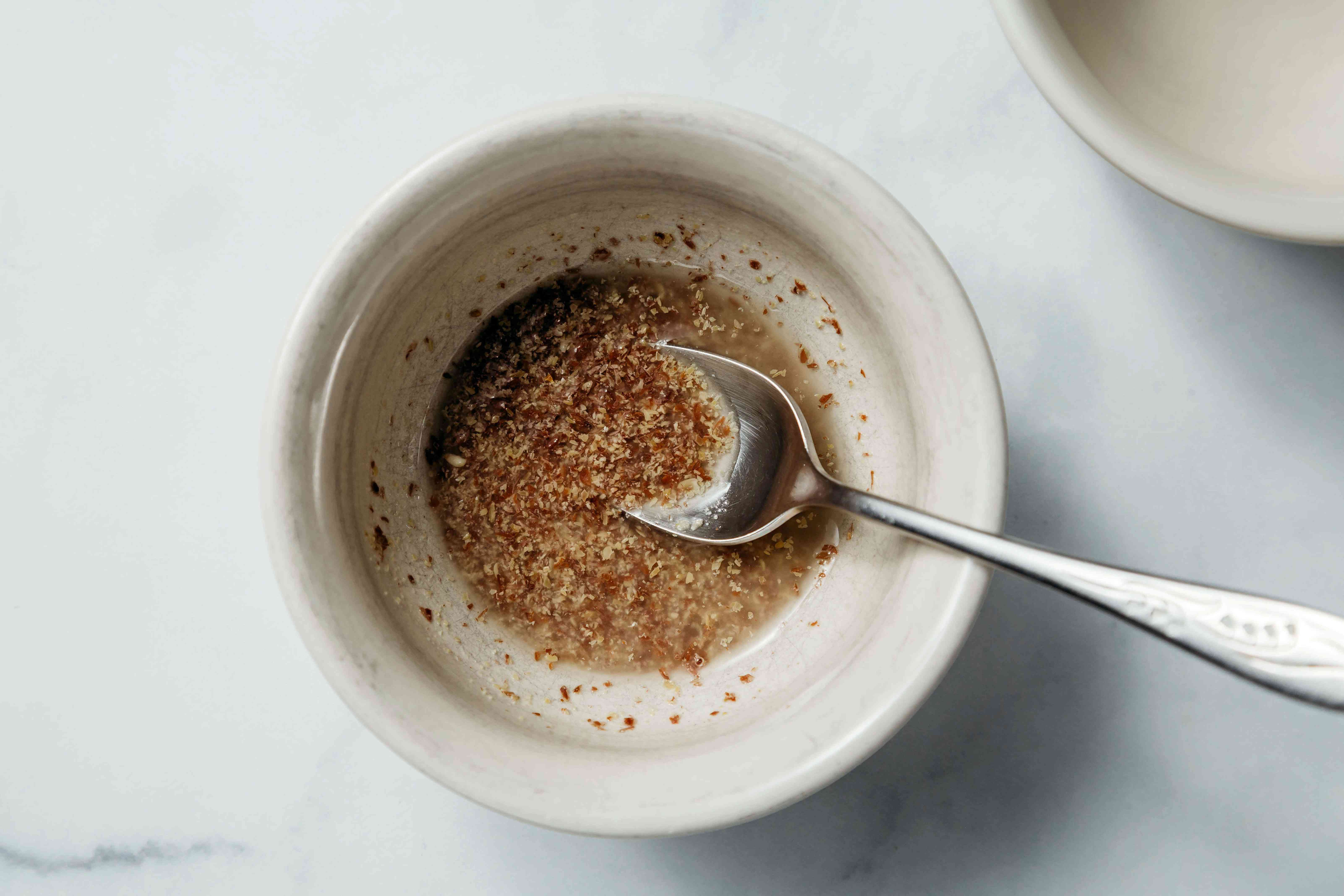 Put the ground flaxseed in a small bowl and add the boiling water