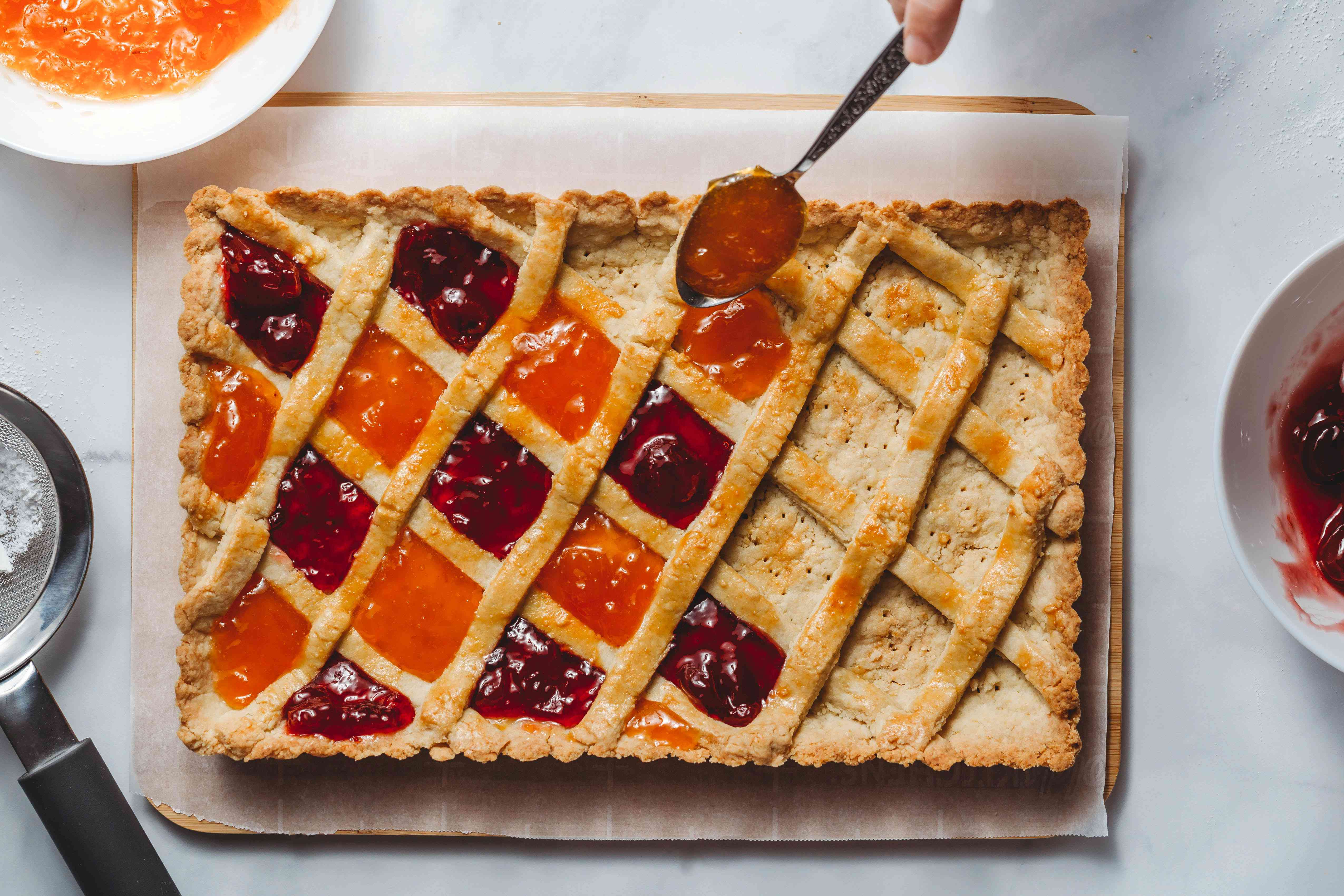 tart being filled with jam