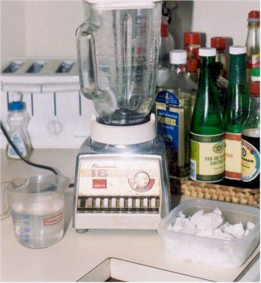 Processing the coconut milk in a blender