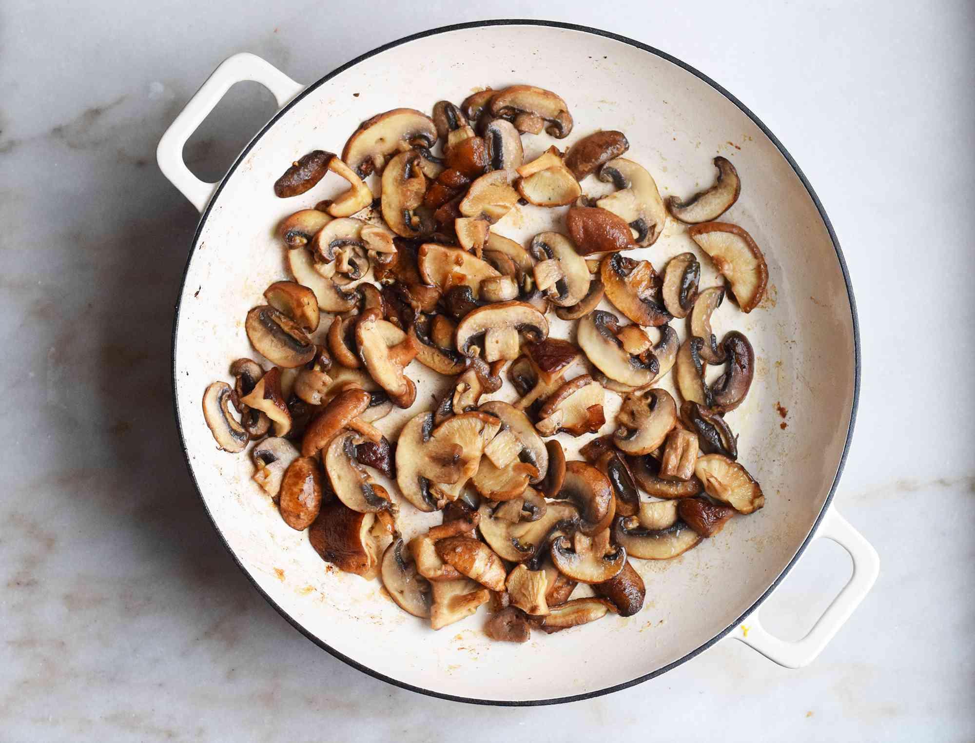 mushrooms sauteed in a saute pan