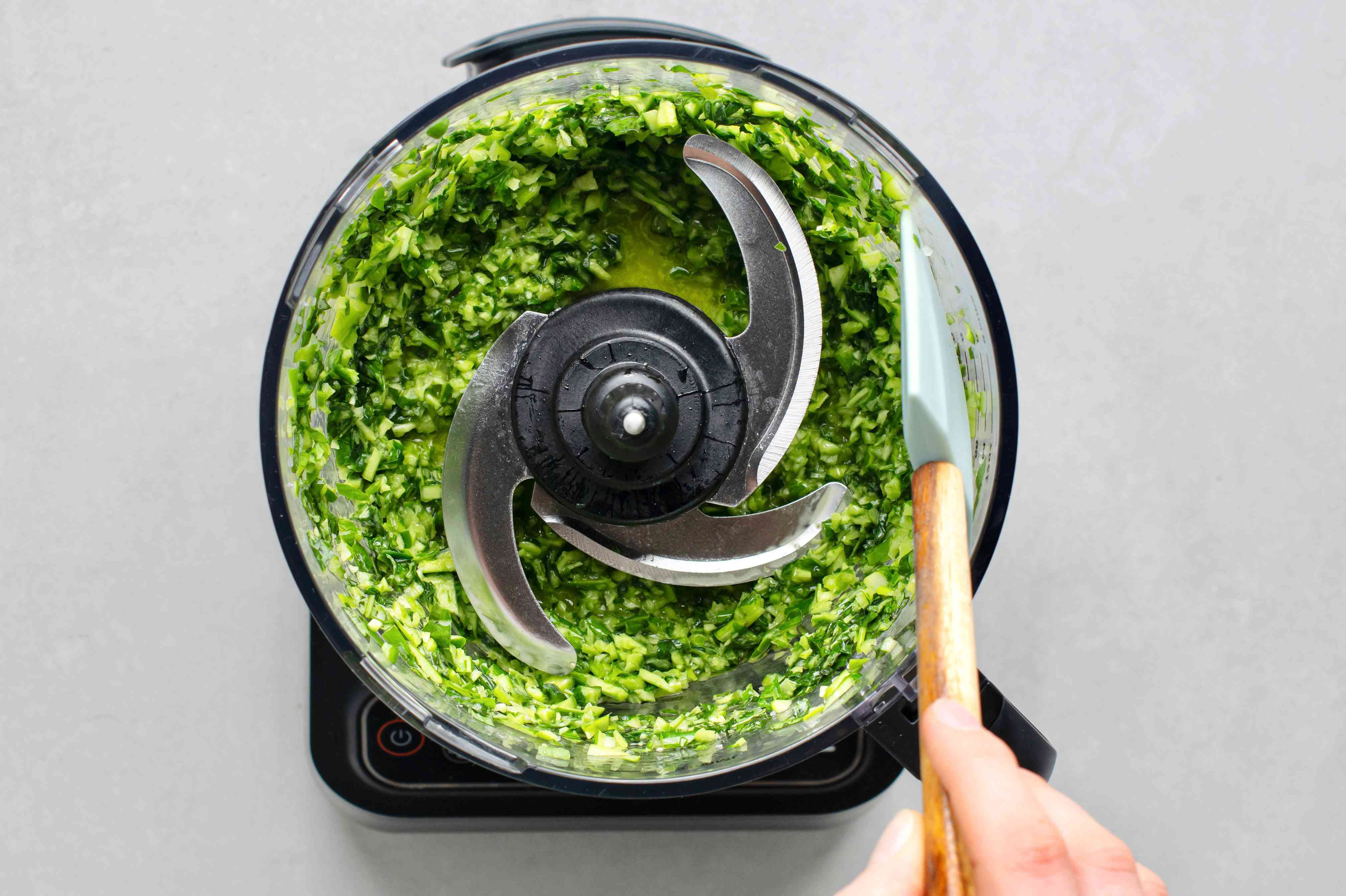 Scrape down the sides of the bowl with a rubber spatula