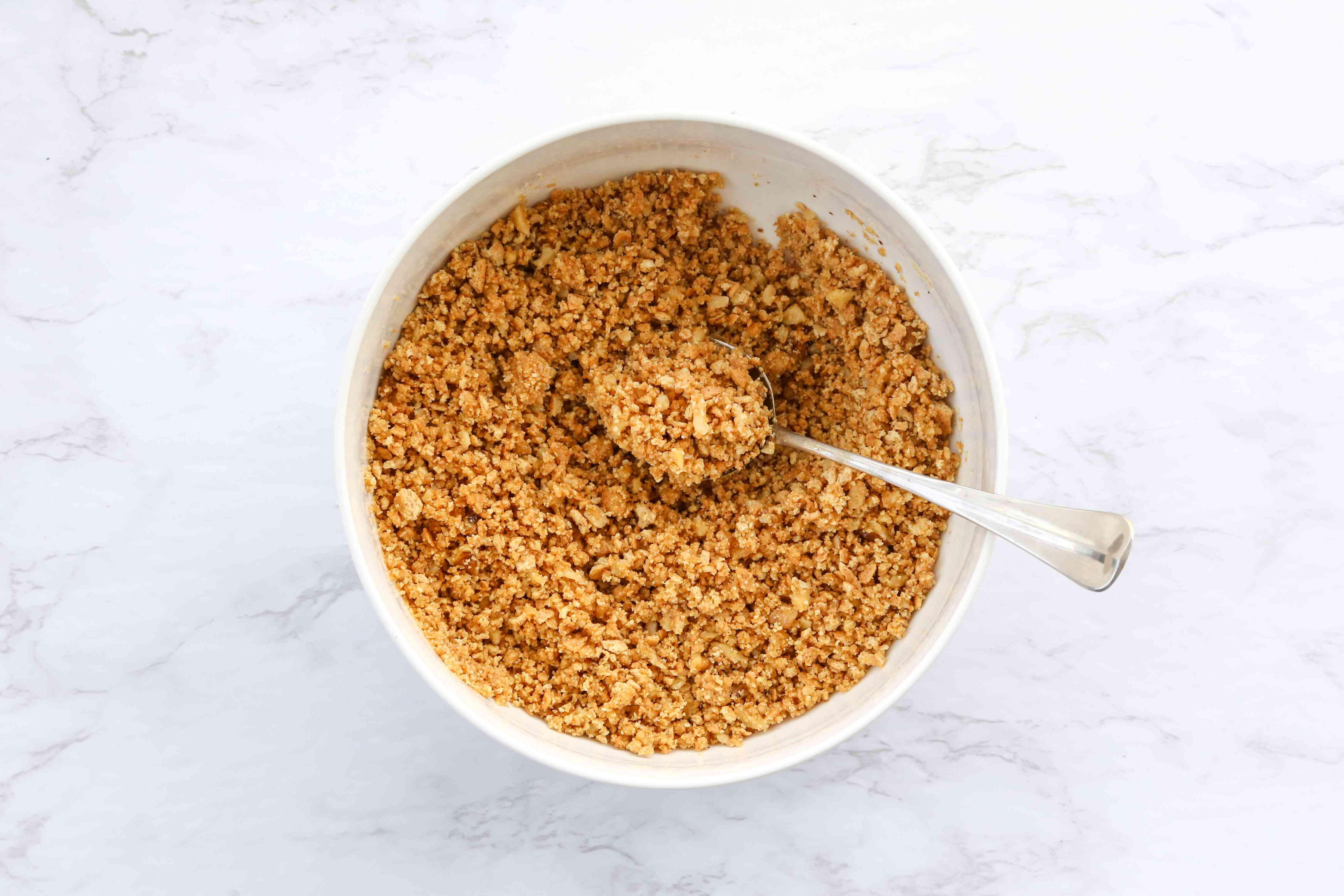combine the graham cracker crumbs, butter, and walnuts in a bowl