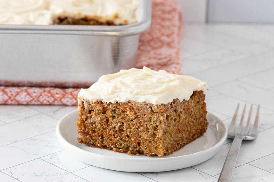 slice of zucchini carrot cake with cream cheese frosting