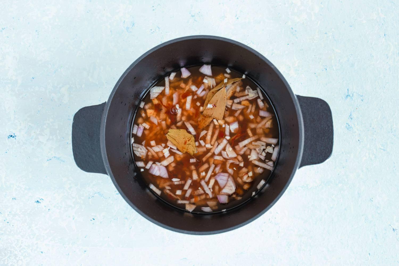 Birria broth in dutch oven.