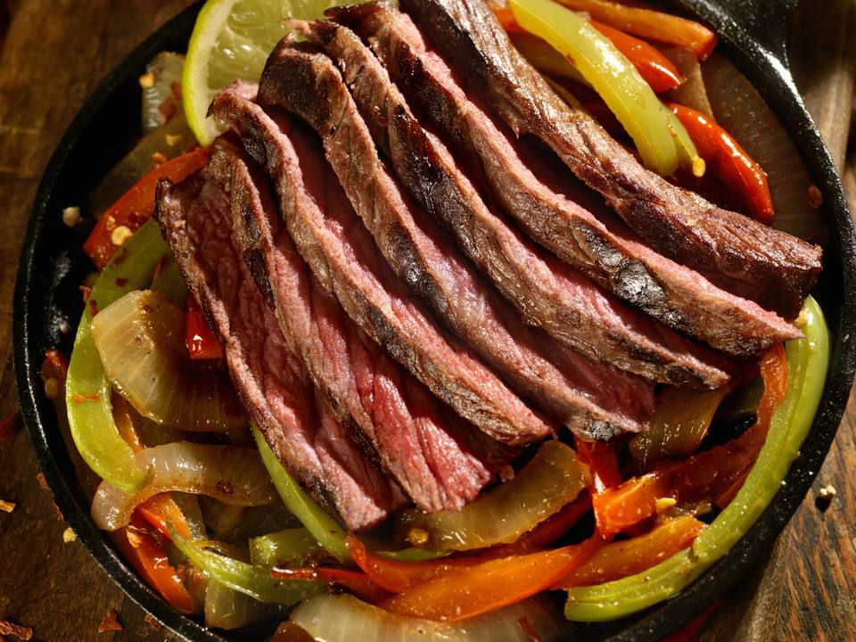 Pepper steak with red and green bell peppers strips