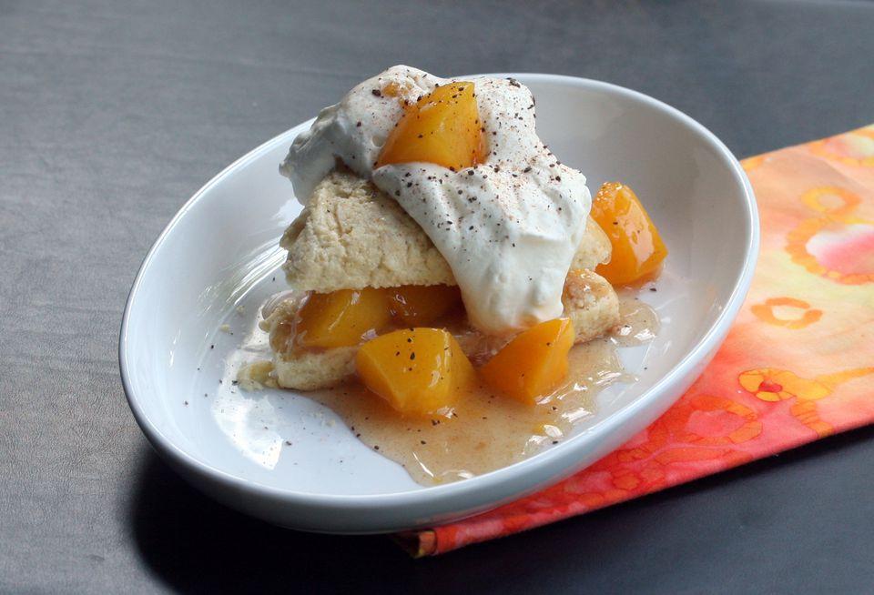 Fresh peach sauce on cream scones.