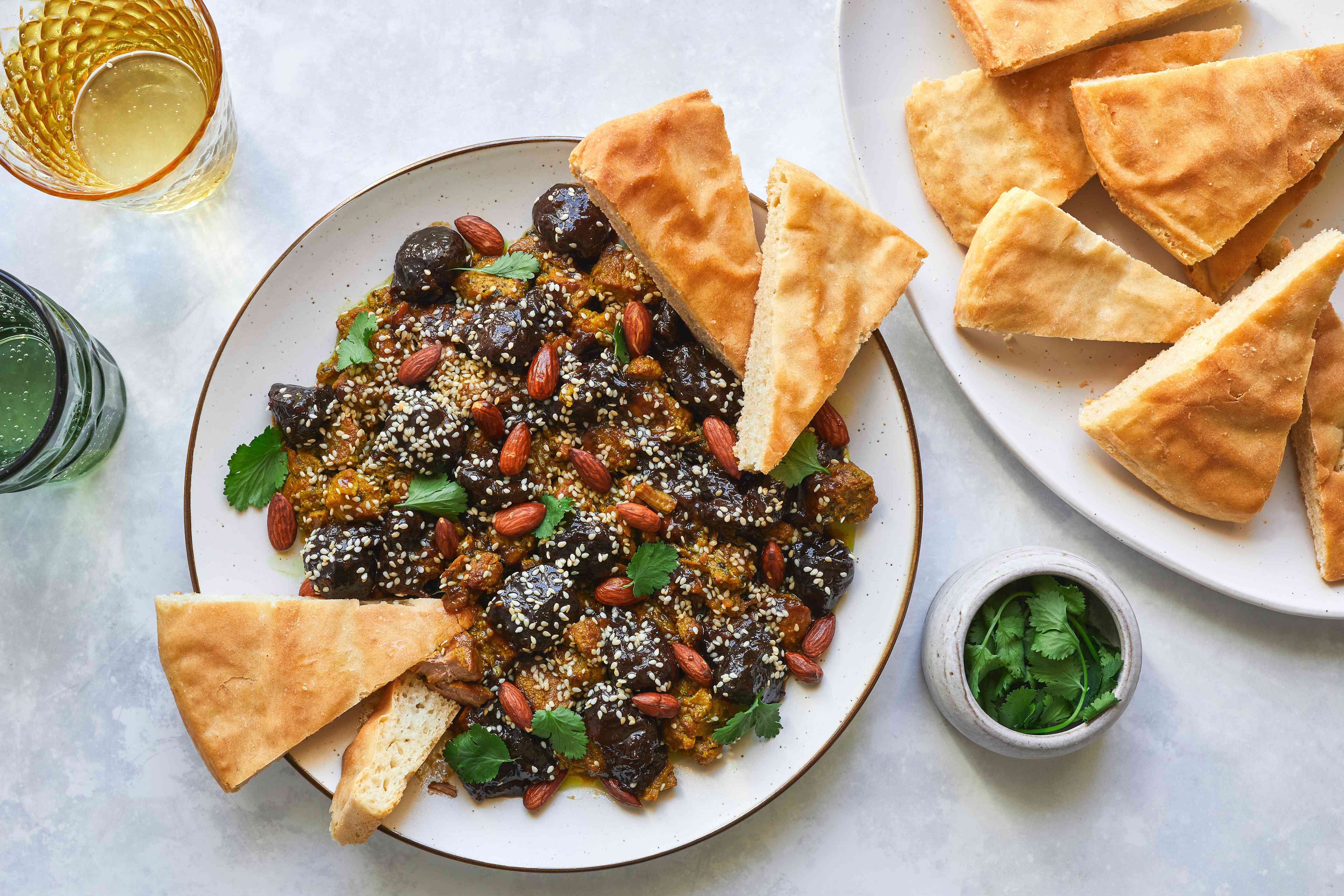 Pressure Cooker Moroccan Lamb or Beef Tagine With Prunes on a plate with garnish