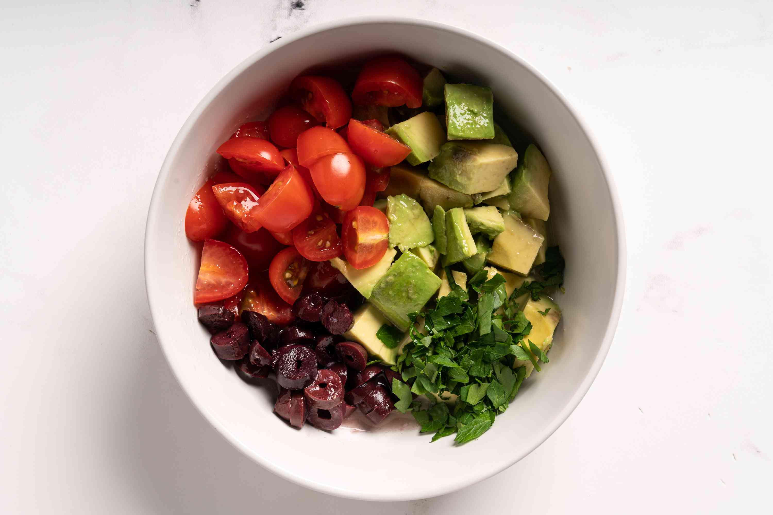 combine the avocado, cherry tomatoes, olives, lemon juice, and parsley in a small bowl