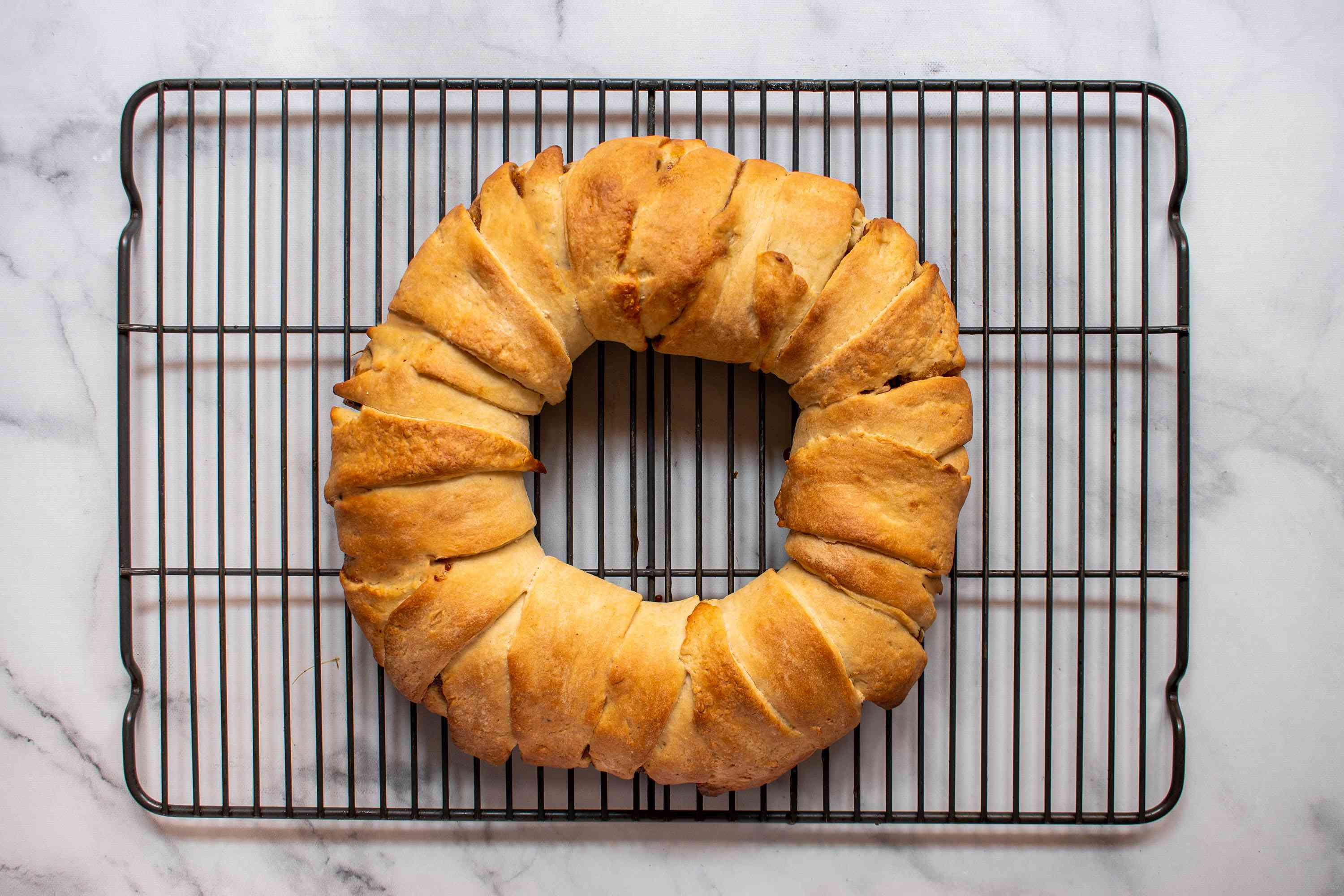 baked king cake on a cooking rack