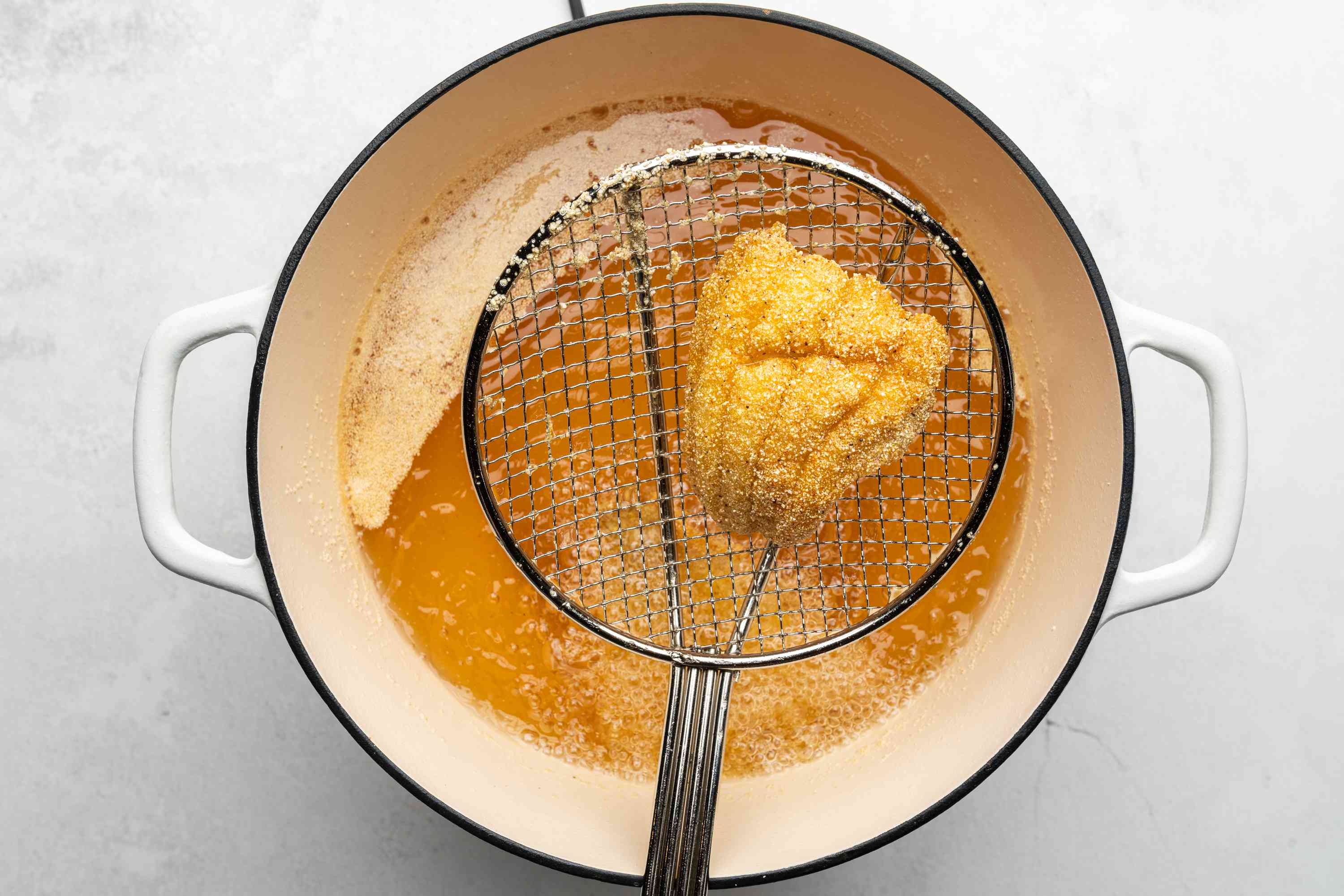 catfish fried in a pot of oil, removed from oil
