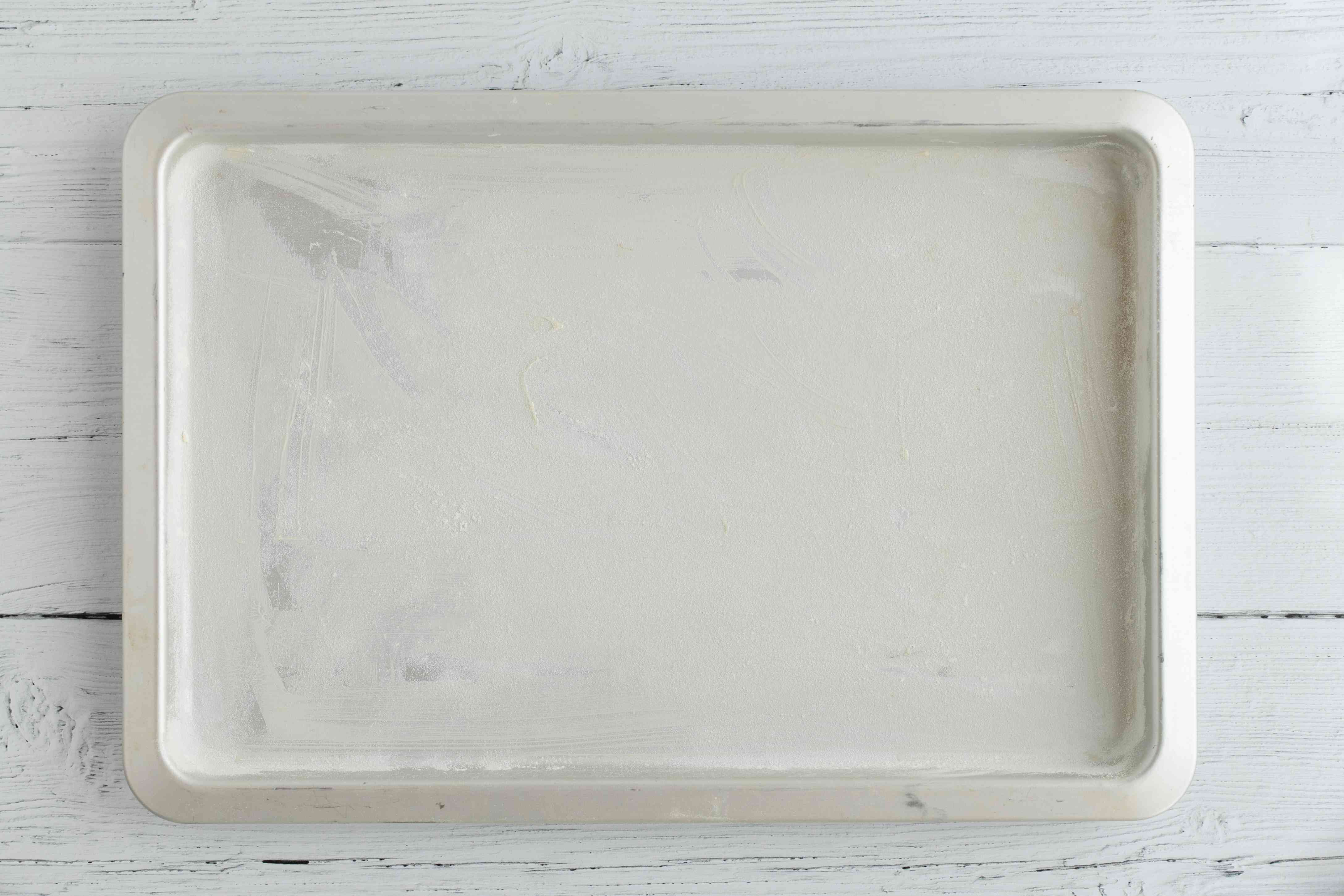 Greased and floured baking sheet