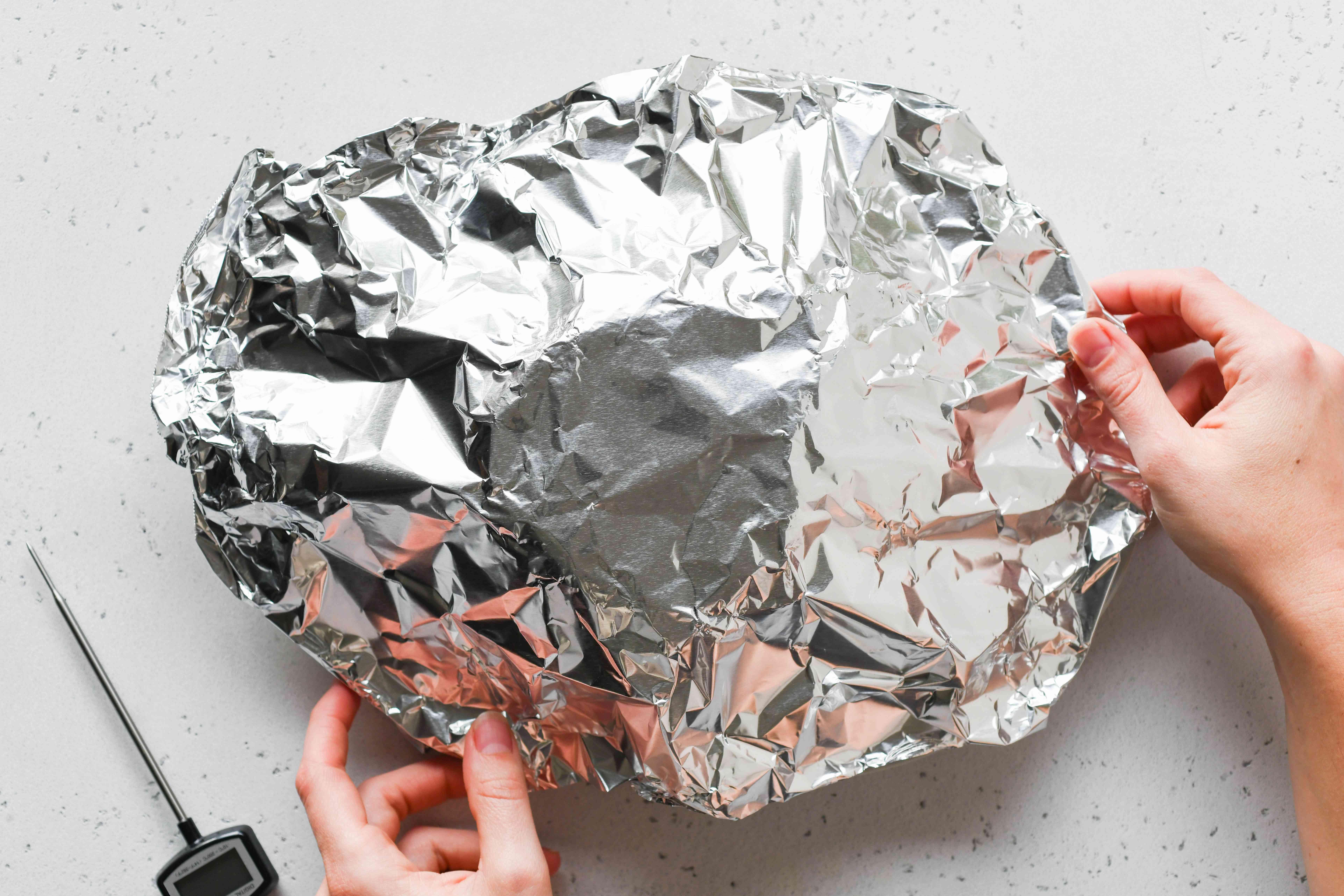 pork shoulder covered with aluminum foil