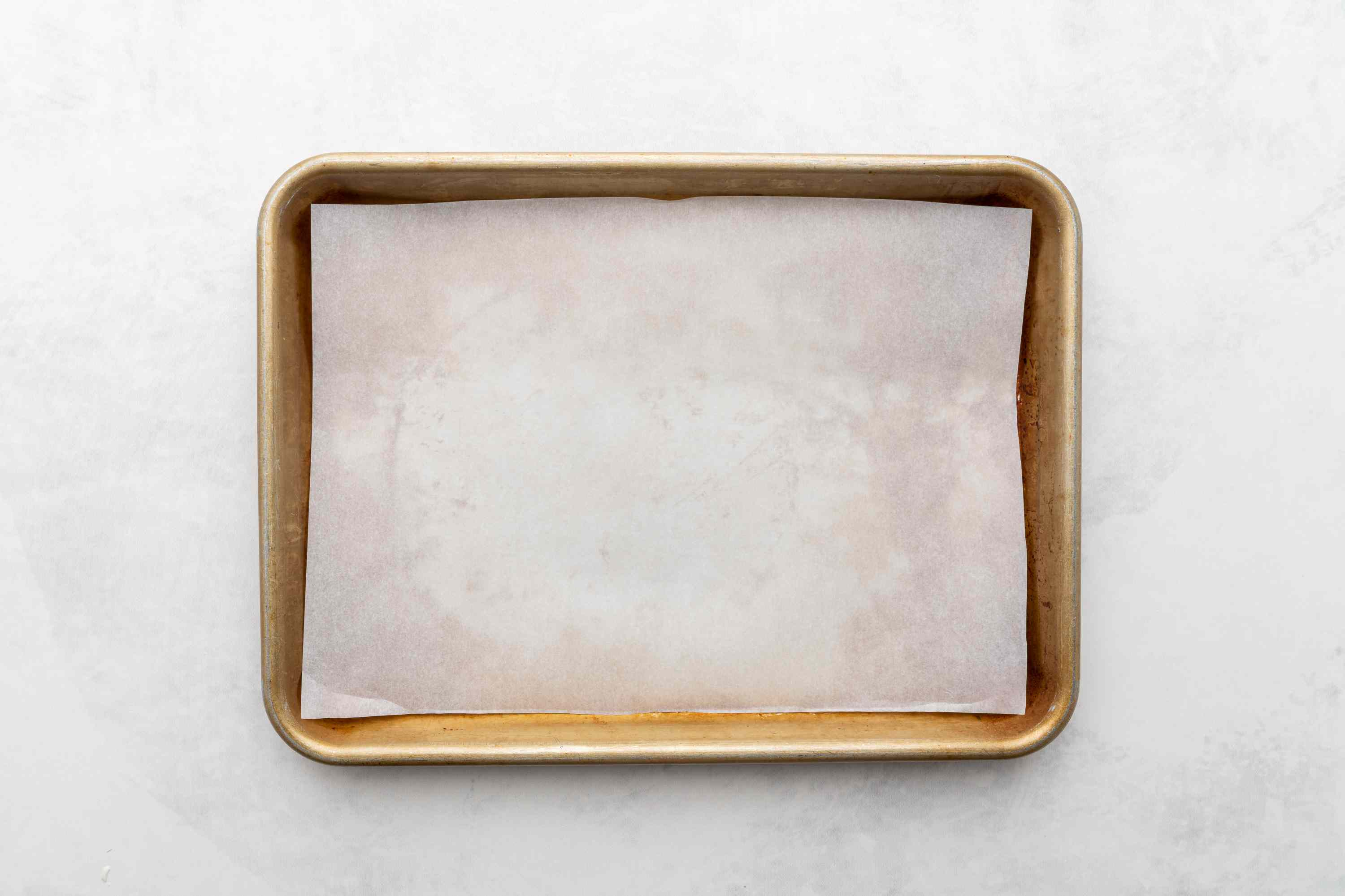 Line a baking sheet with waxed paper