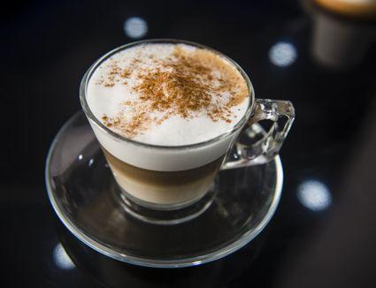 Cappuccino With Cocoa Powder in a Coffee Shop