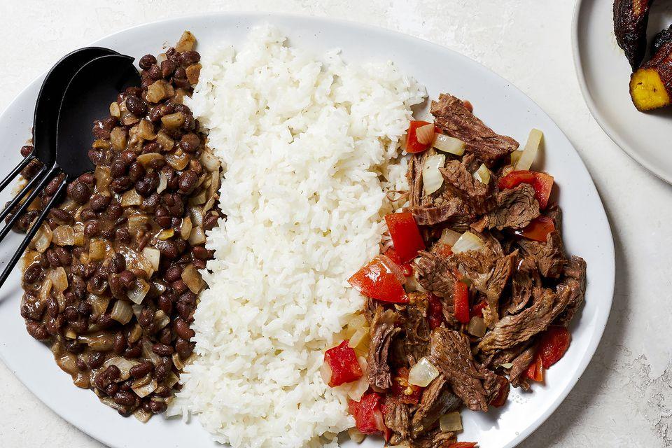 A plate of Venezuelan steak, rice, and beans