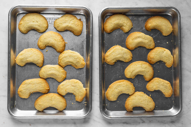 Polish Almond Crescent Cookies (Rogaliki) on baking sheets