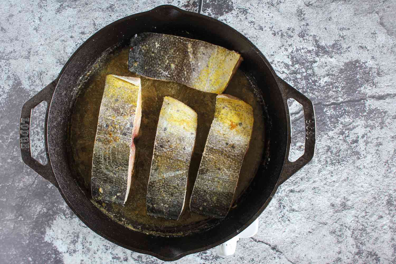 Return fish to skillet