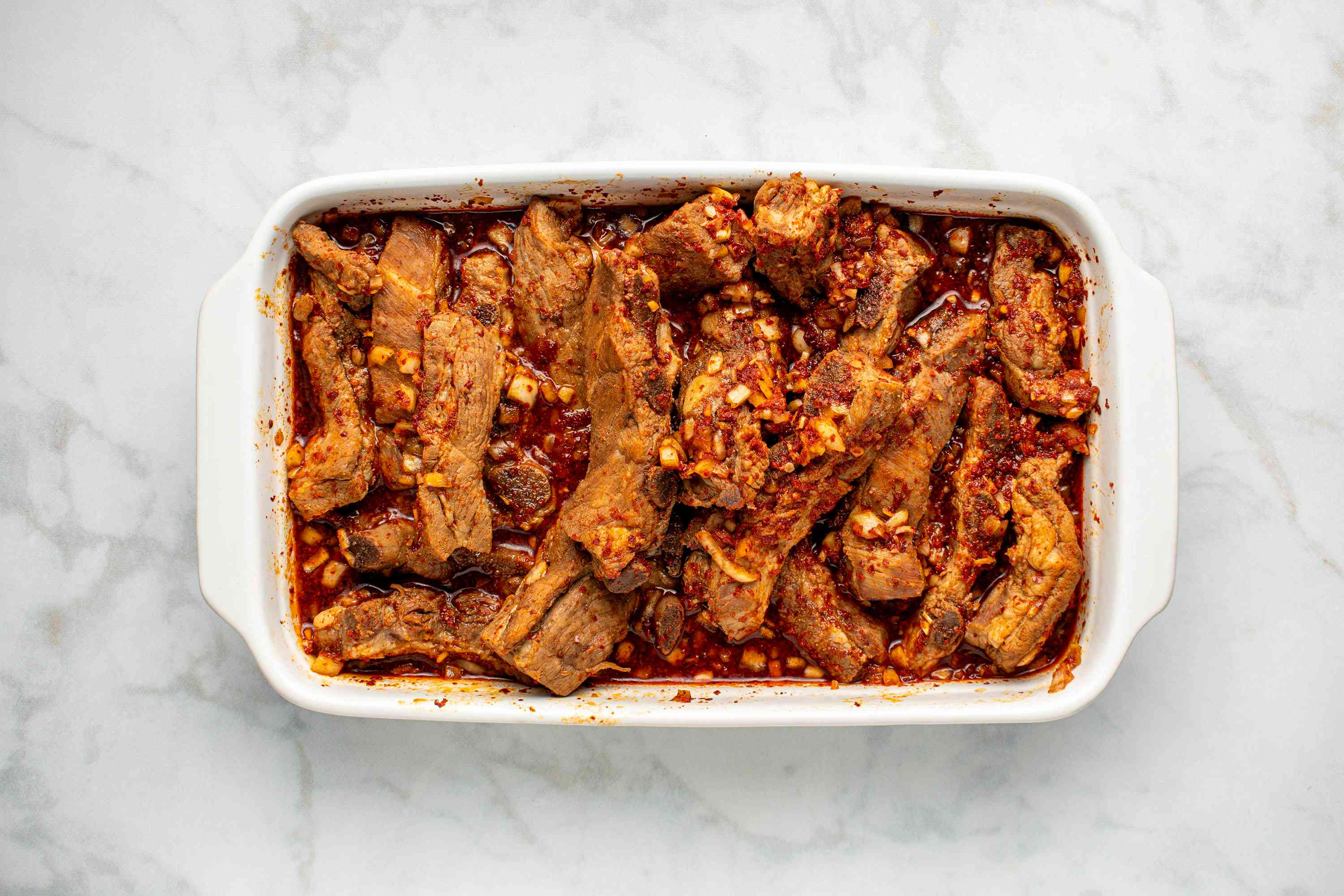 meat and marinade in a baking dish