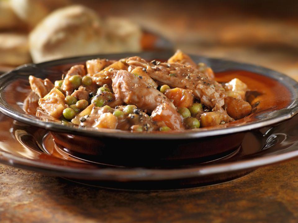 Peruvian stewed chicken in cilantro sauce (seco de pollo)