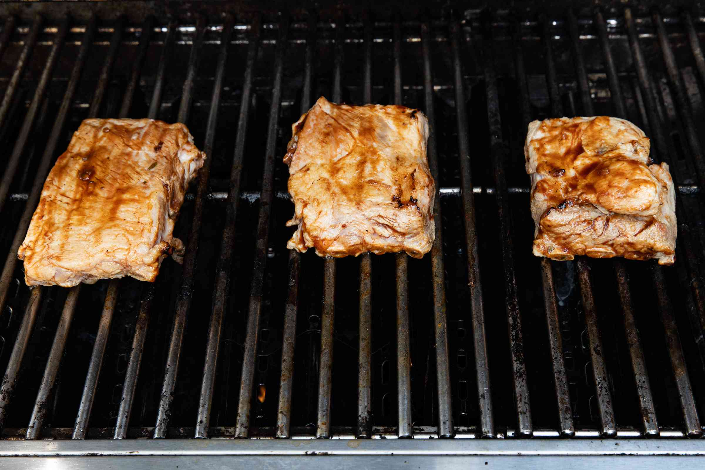 spareribs cooking on the grill