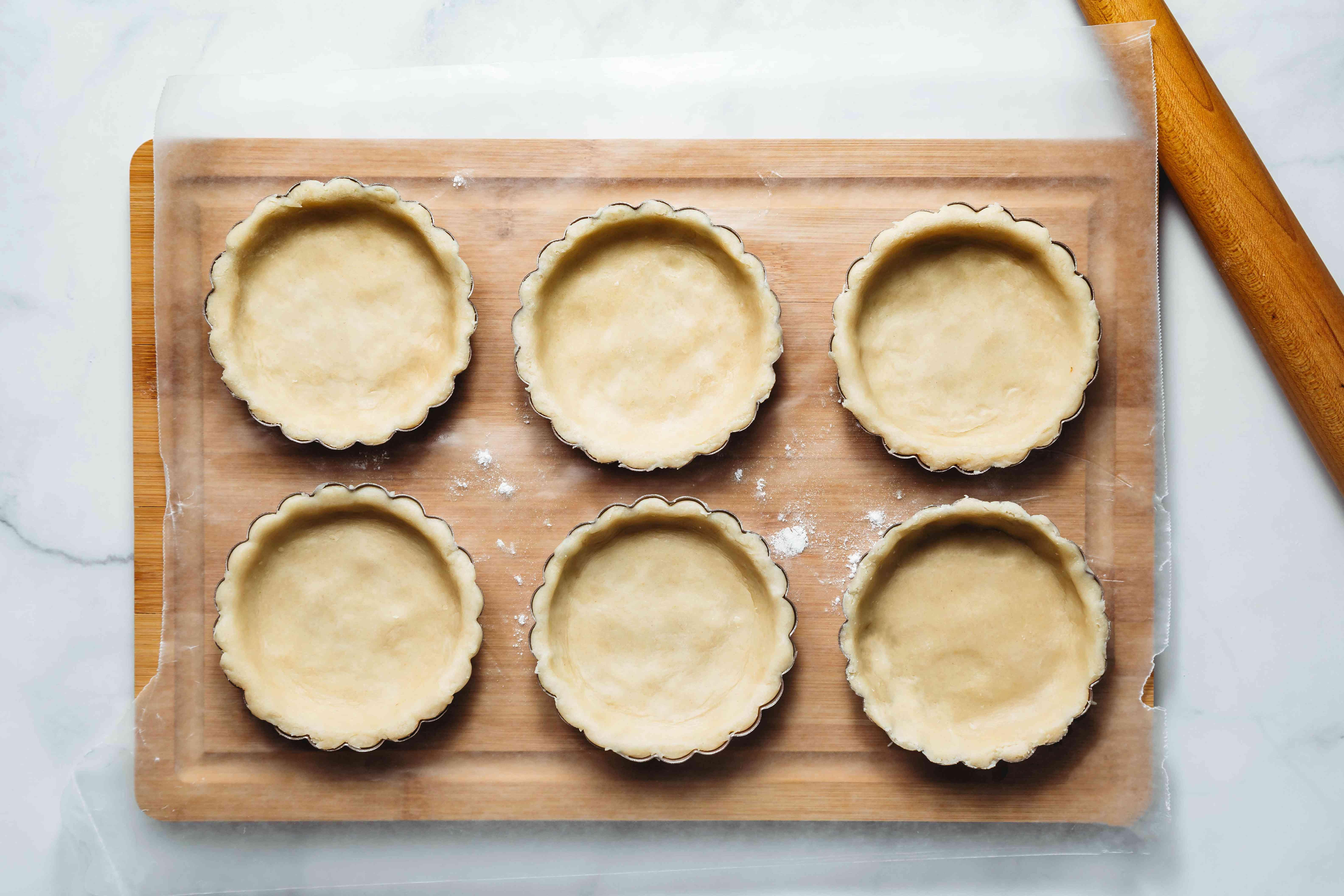 tart dough in tart tins