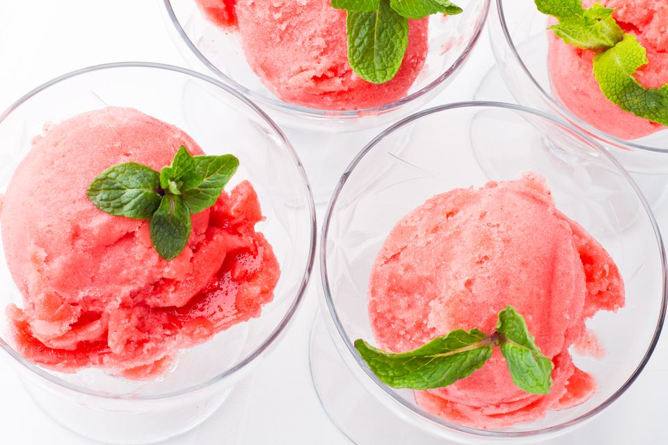 Strawberry sorbet with fresh mint garnish