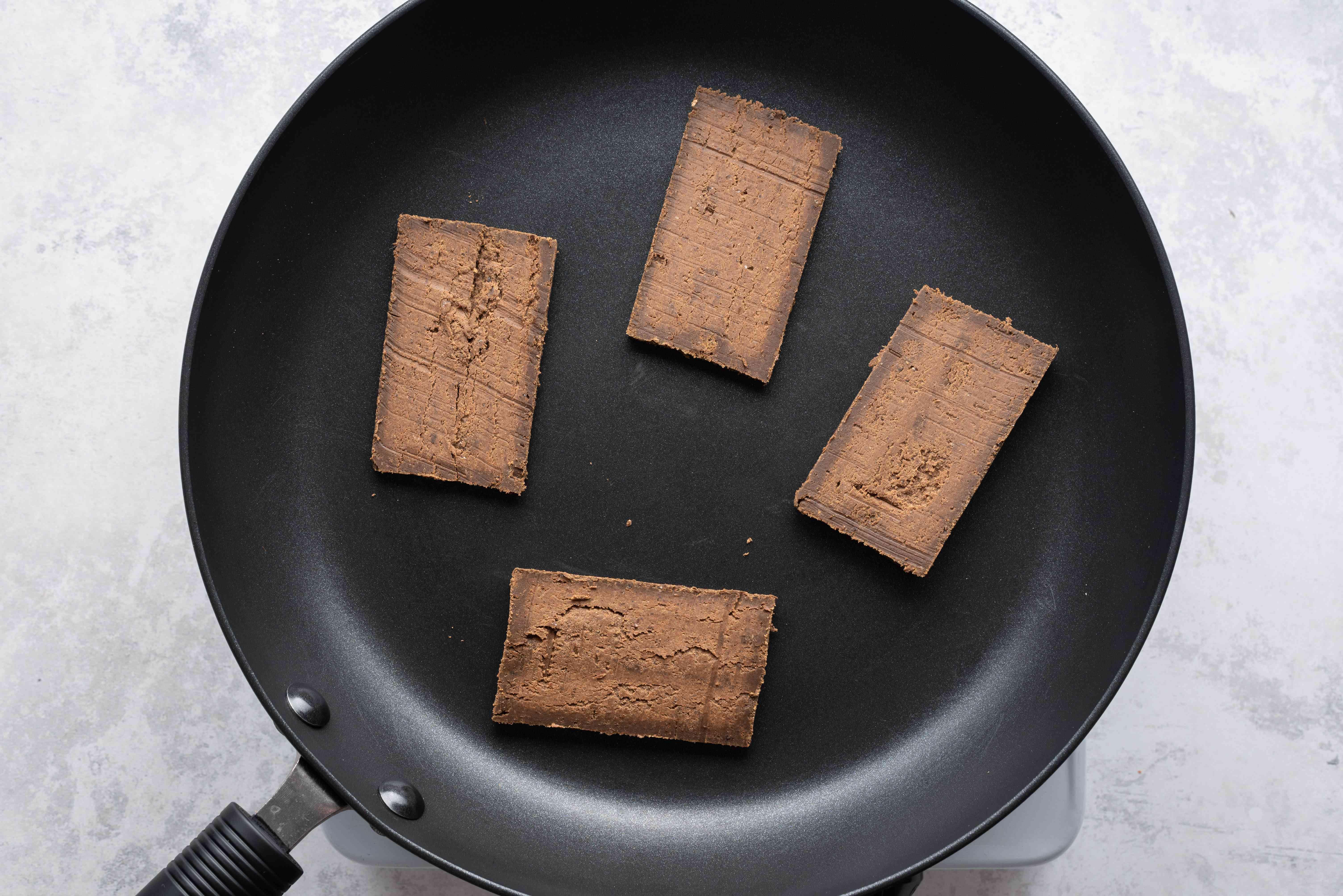 Belacan (Dried Shrimp Paste) in a pan