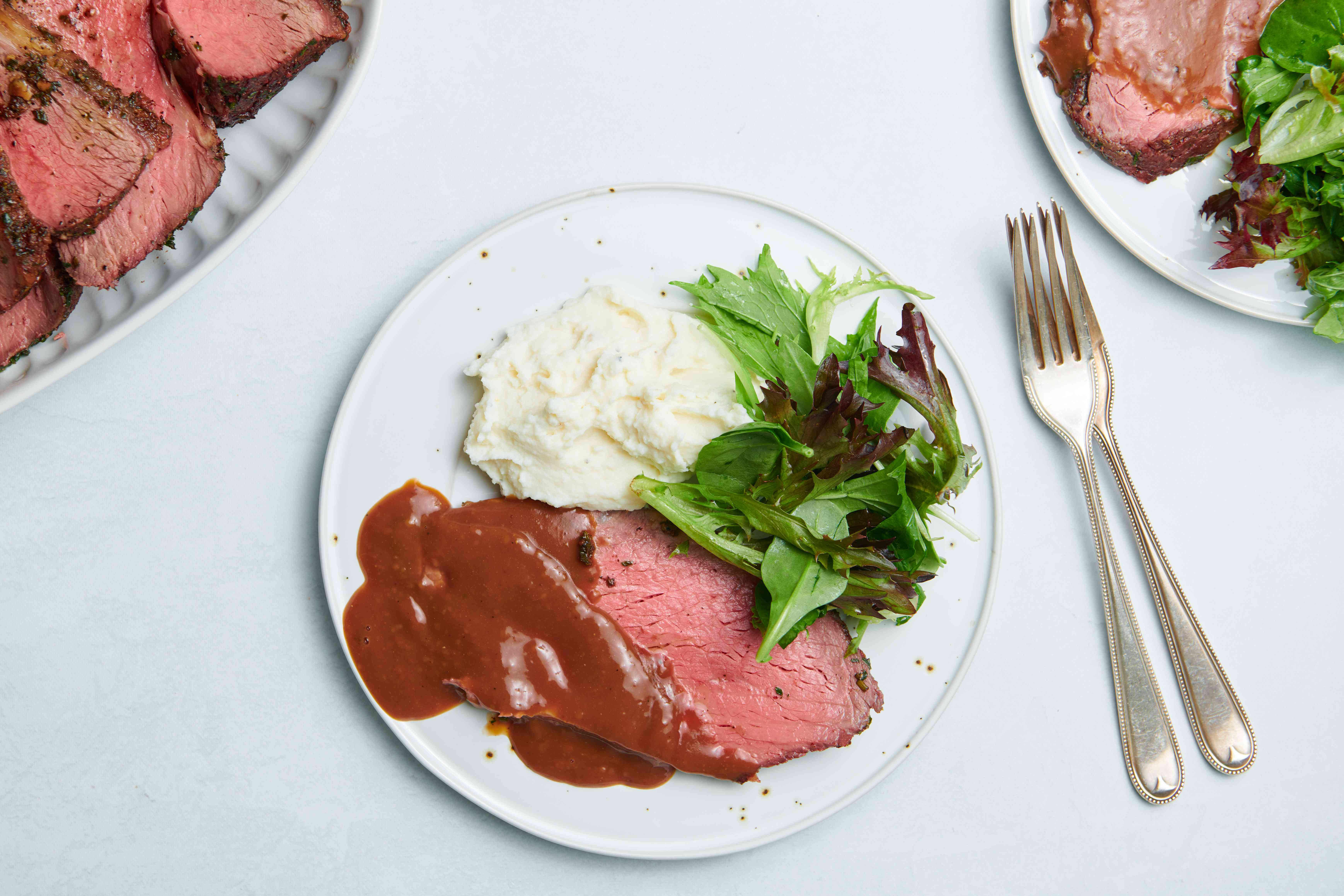 Pepper and Herb Crusted Sirloin Strip Roast, served mashed potatoes and salad