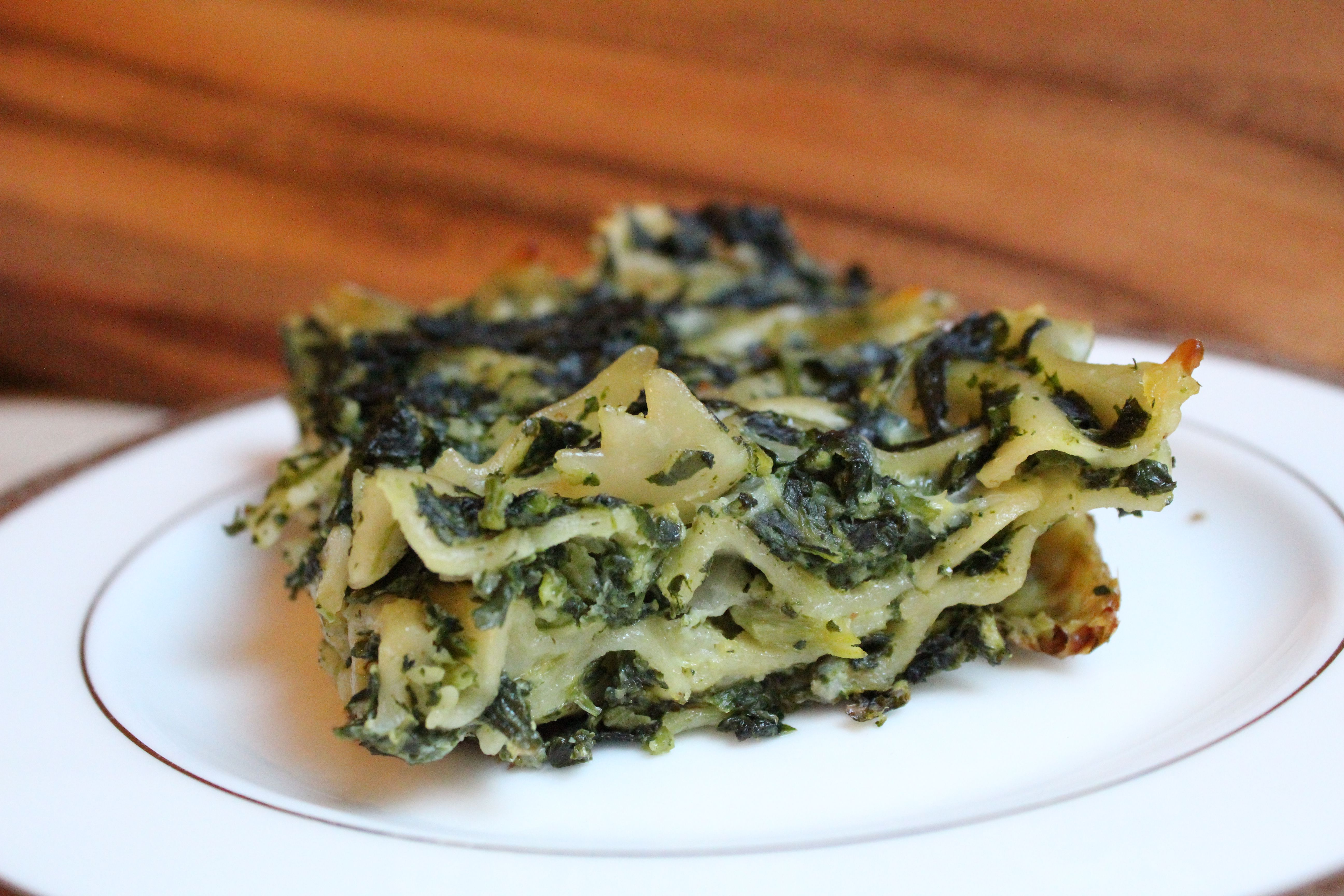 A slice of spinach noodle kugel on a plate