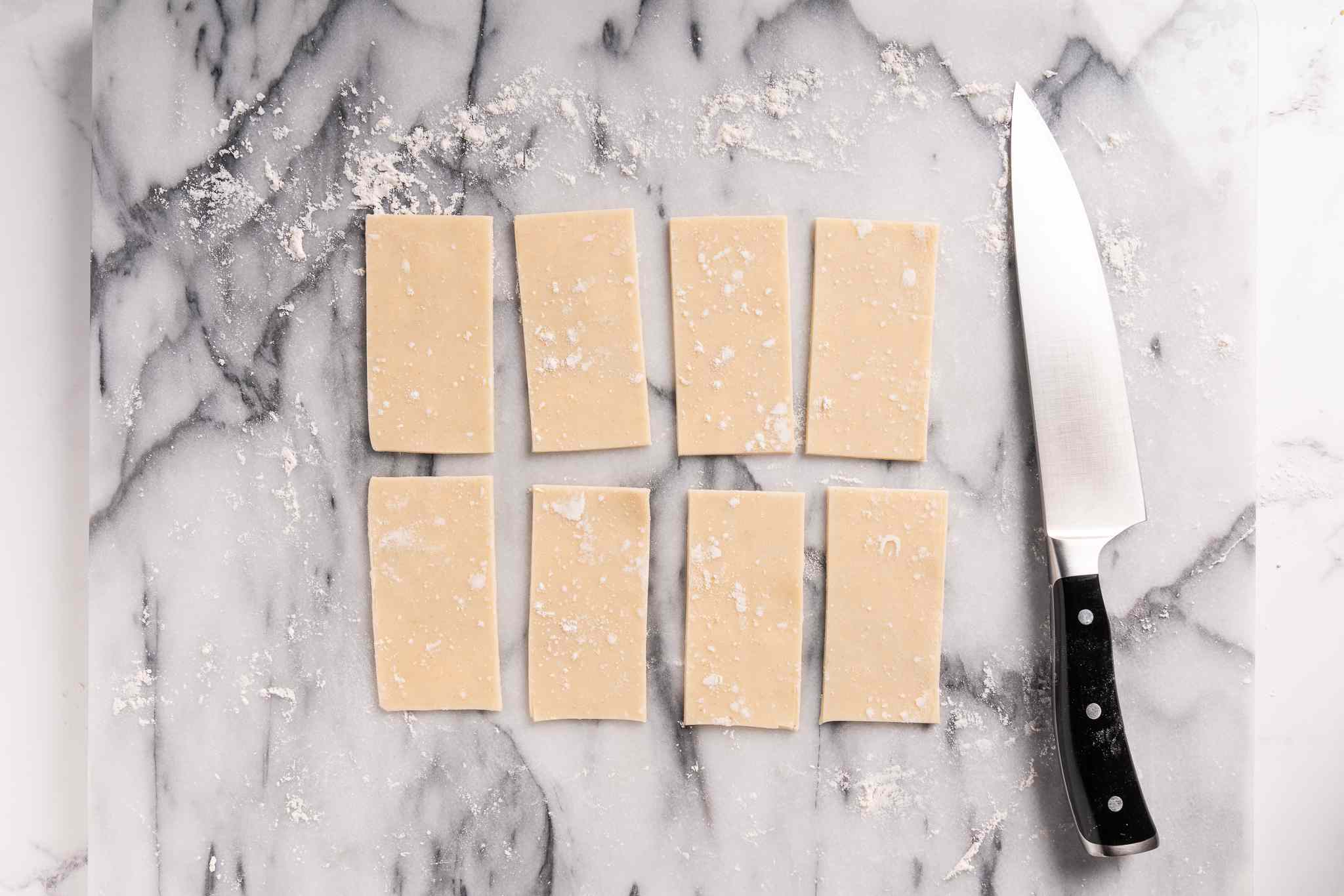 Pie crust cut into rectangles with a knife