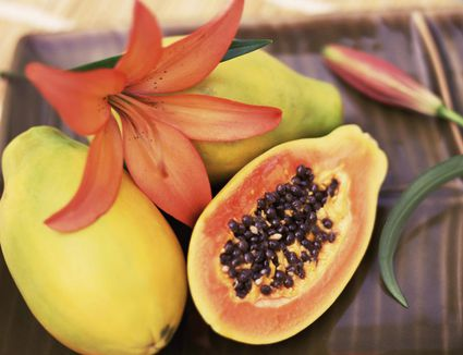 Whole and sliced papaya