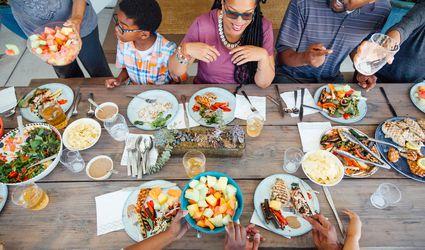 Family eating meal outside