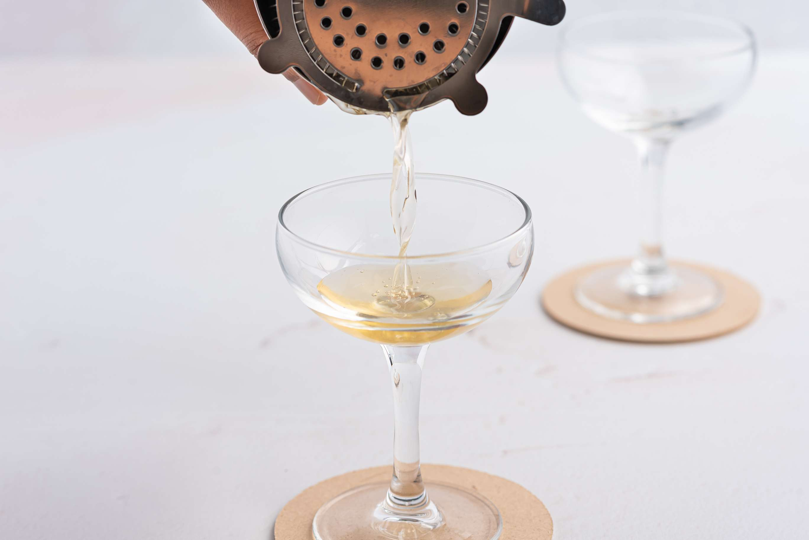 Strain the cocktail into a glass