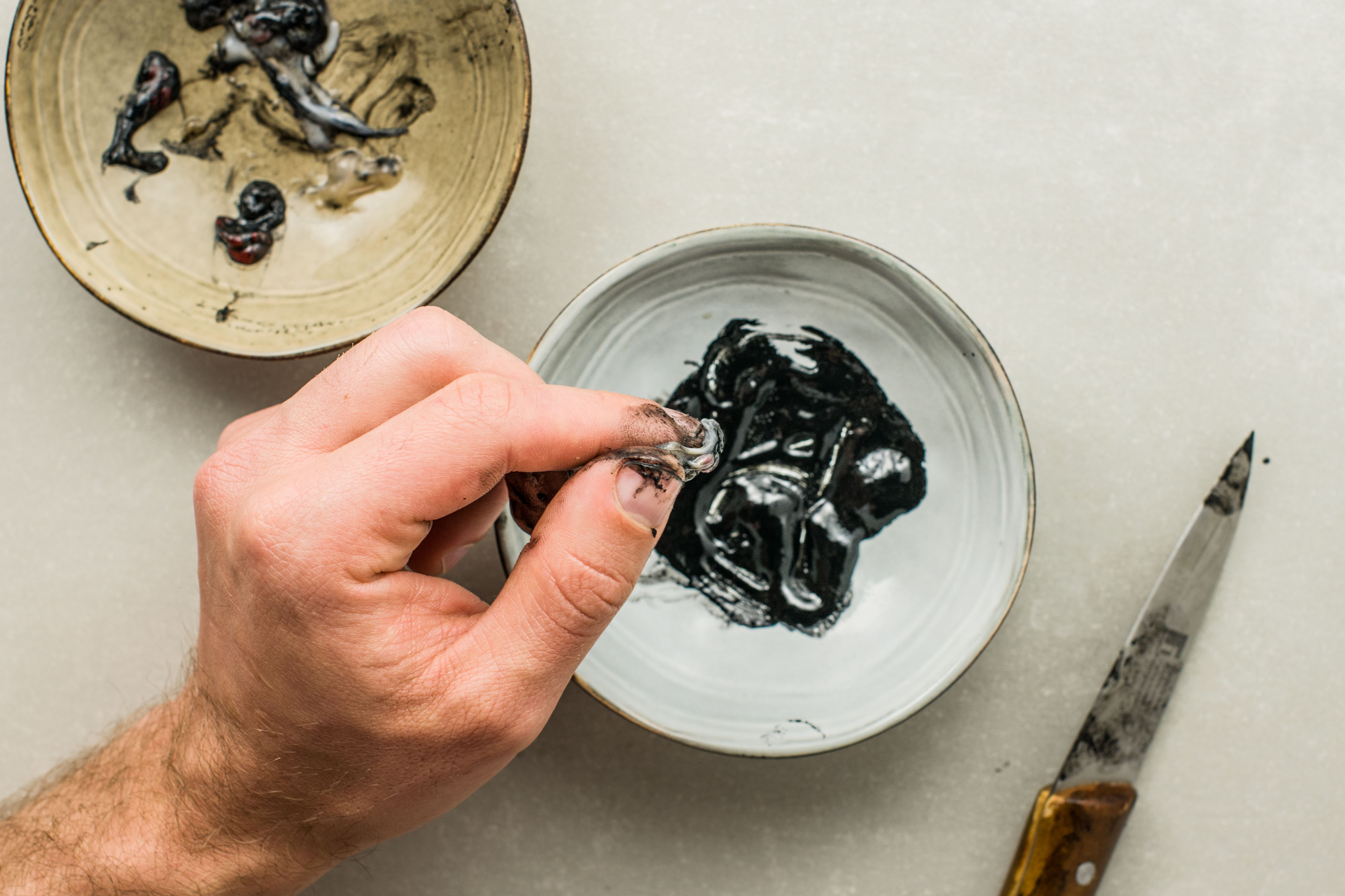 Squid ink collected in a small bowl